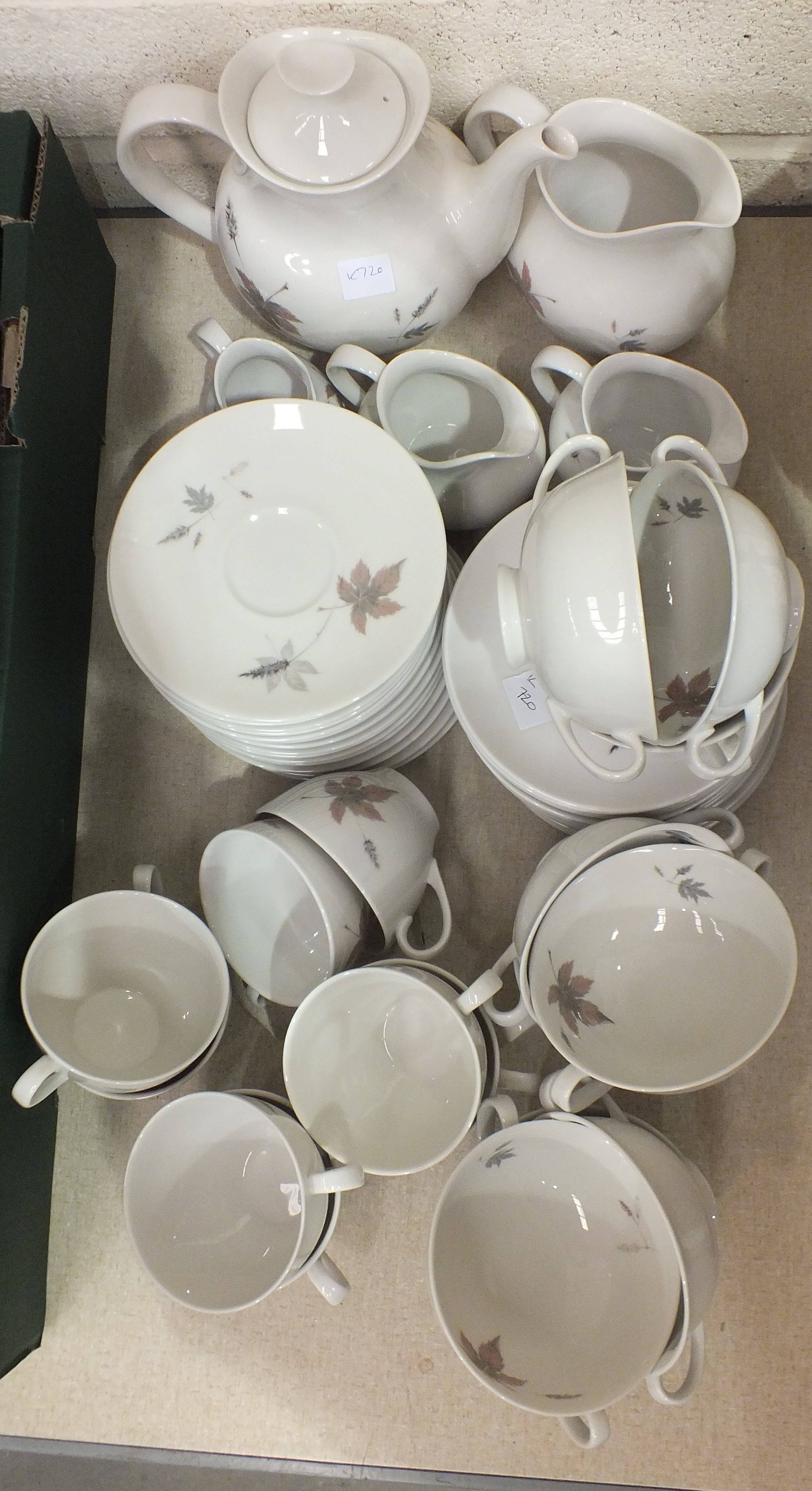Lot 63 - A Royal Doulton dinner and tea part-service in the 'Tumbling Leaves' pattern, approximately 80