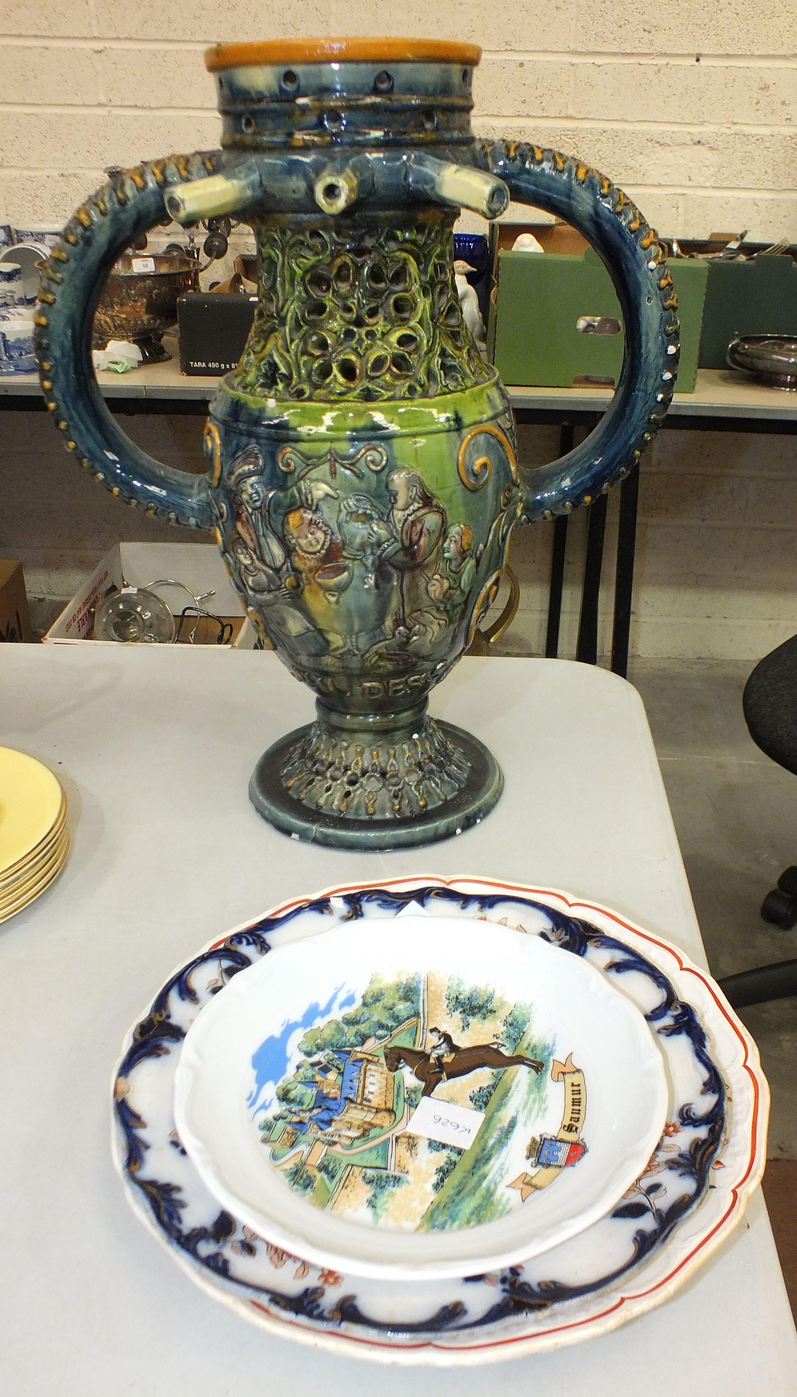 Lot 98 - A majolica puzzle jug, (a/f), 42cm high and four ceramic plates, (5).