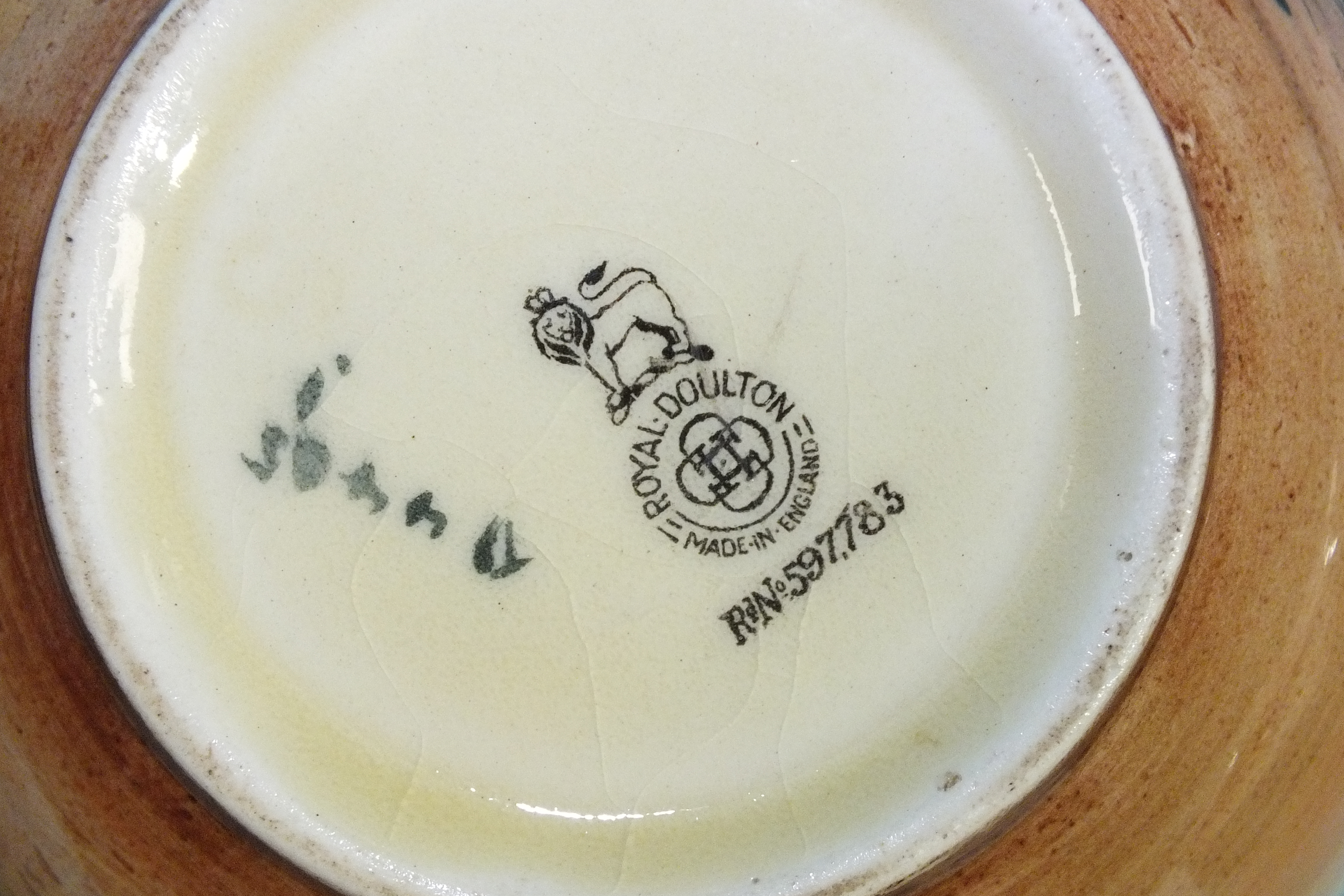 """Lot 78 - A Royal Doulton Dickens ware charger signed 'Noke', """"Tony Weller"""", 34cm diameter, a Royal Doulton"""