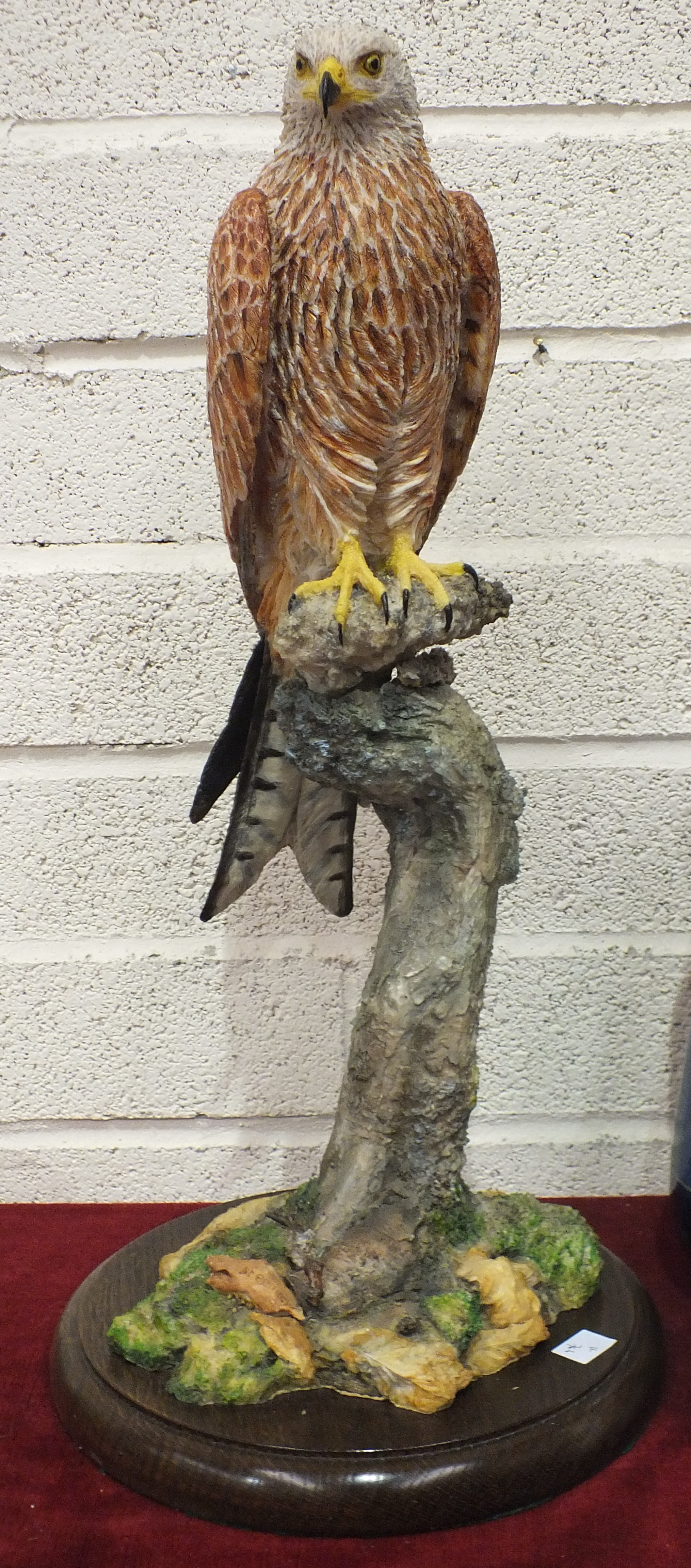 Lot 67 - A composite model of a Red Kite perched on a naturalistic base, indistinct impressed signature, 64cm