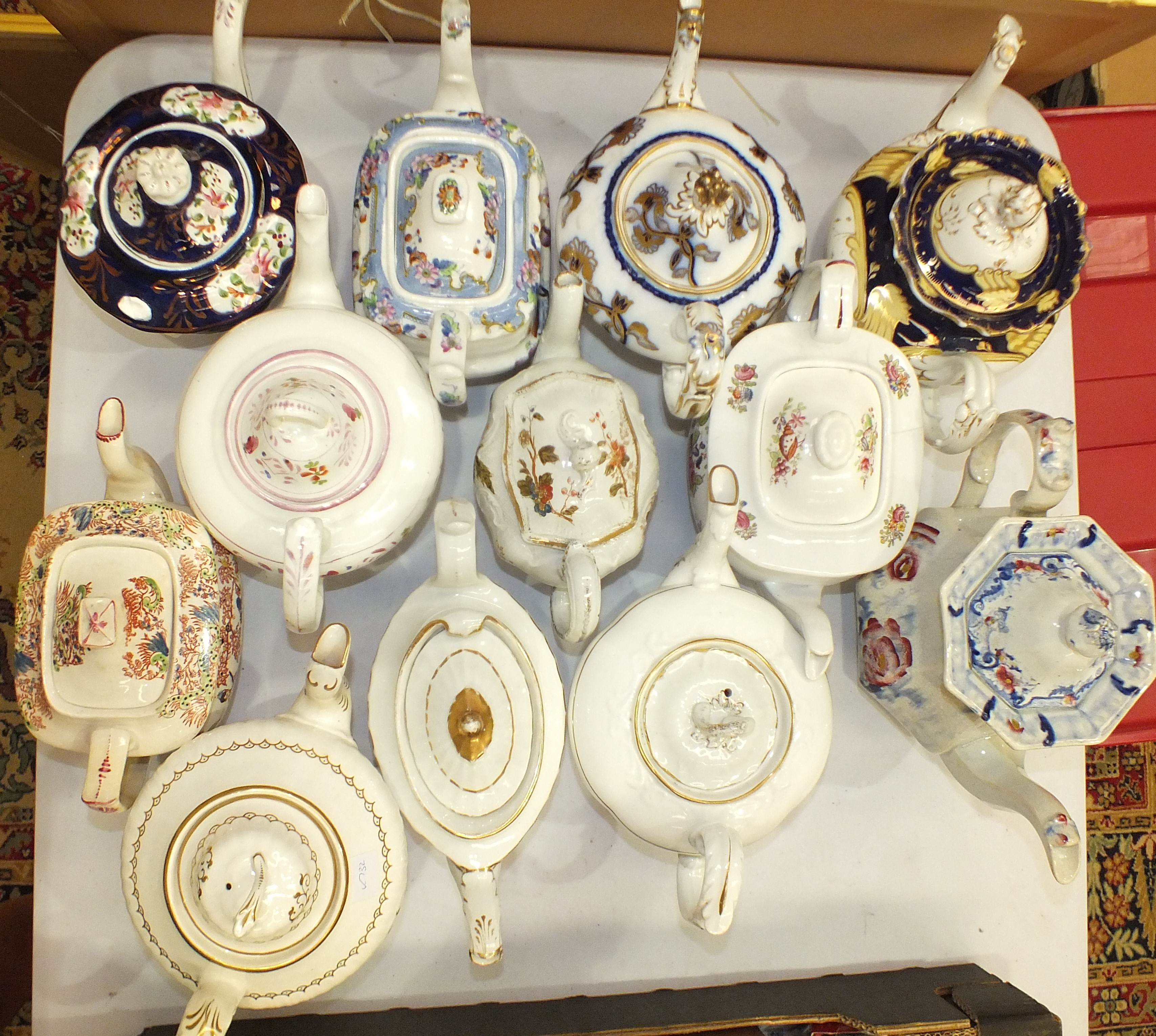 Lot 117 - A collection of twelve 19th century and later ceramic teapots.