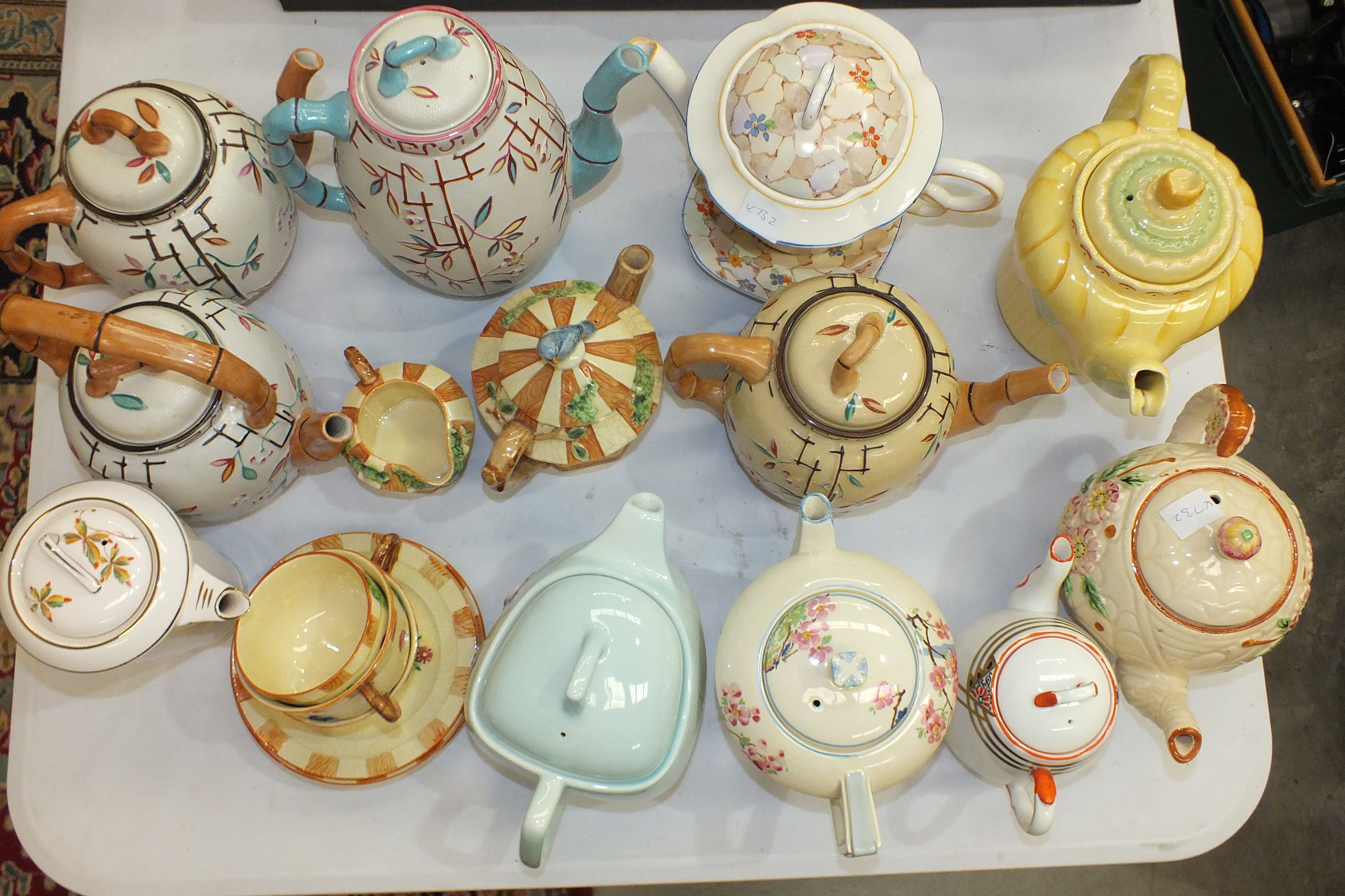 Lot 103 - Four Brownhills Pottery bamboo-ware teapots, a Carlton Ware columbine teapot and others.