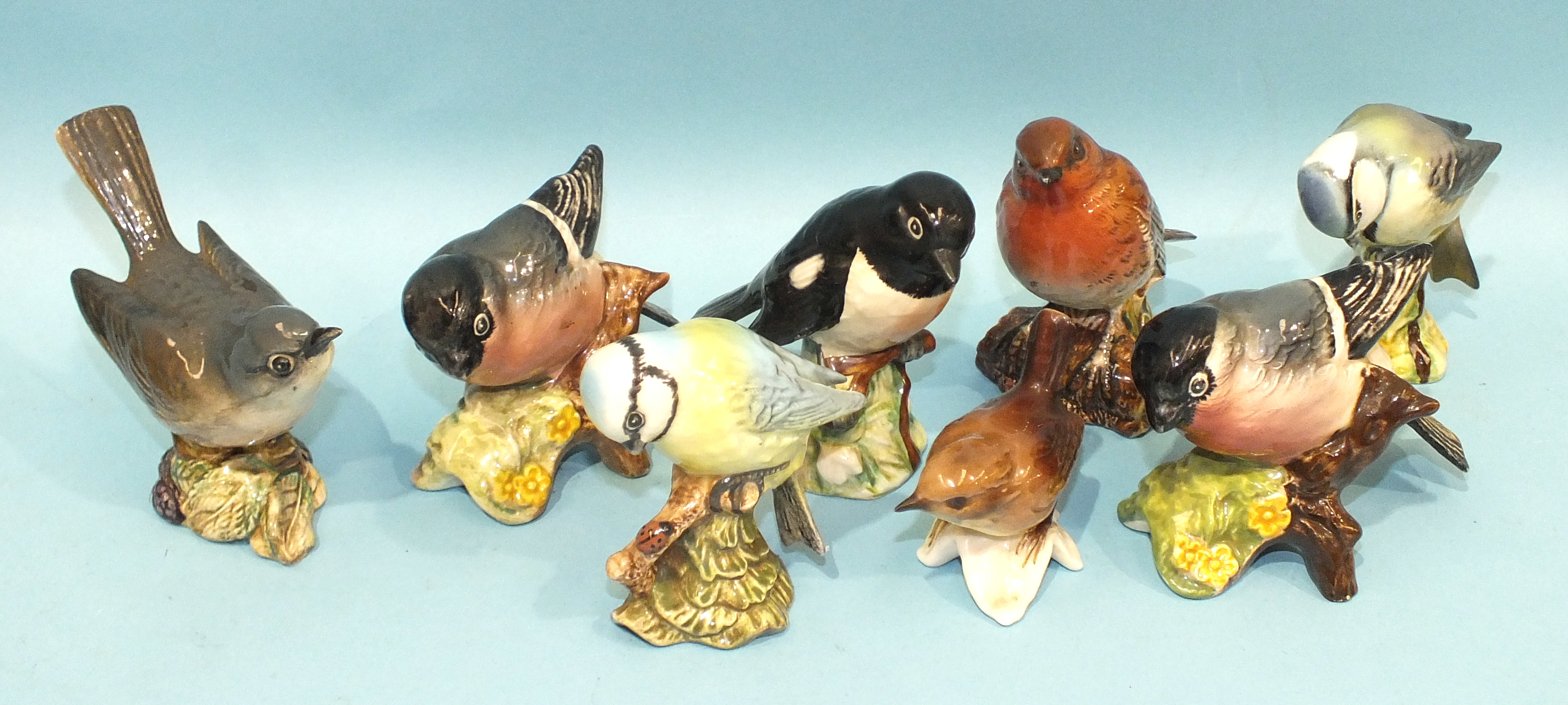 Lot 130 - A collection of seven Beswick small bird models: Whitethroat, Bullfinch (x2), Blue Tit (x2),