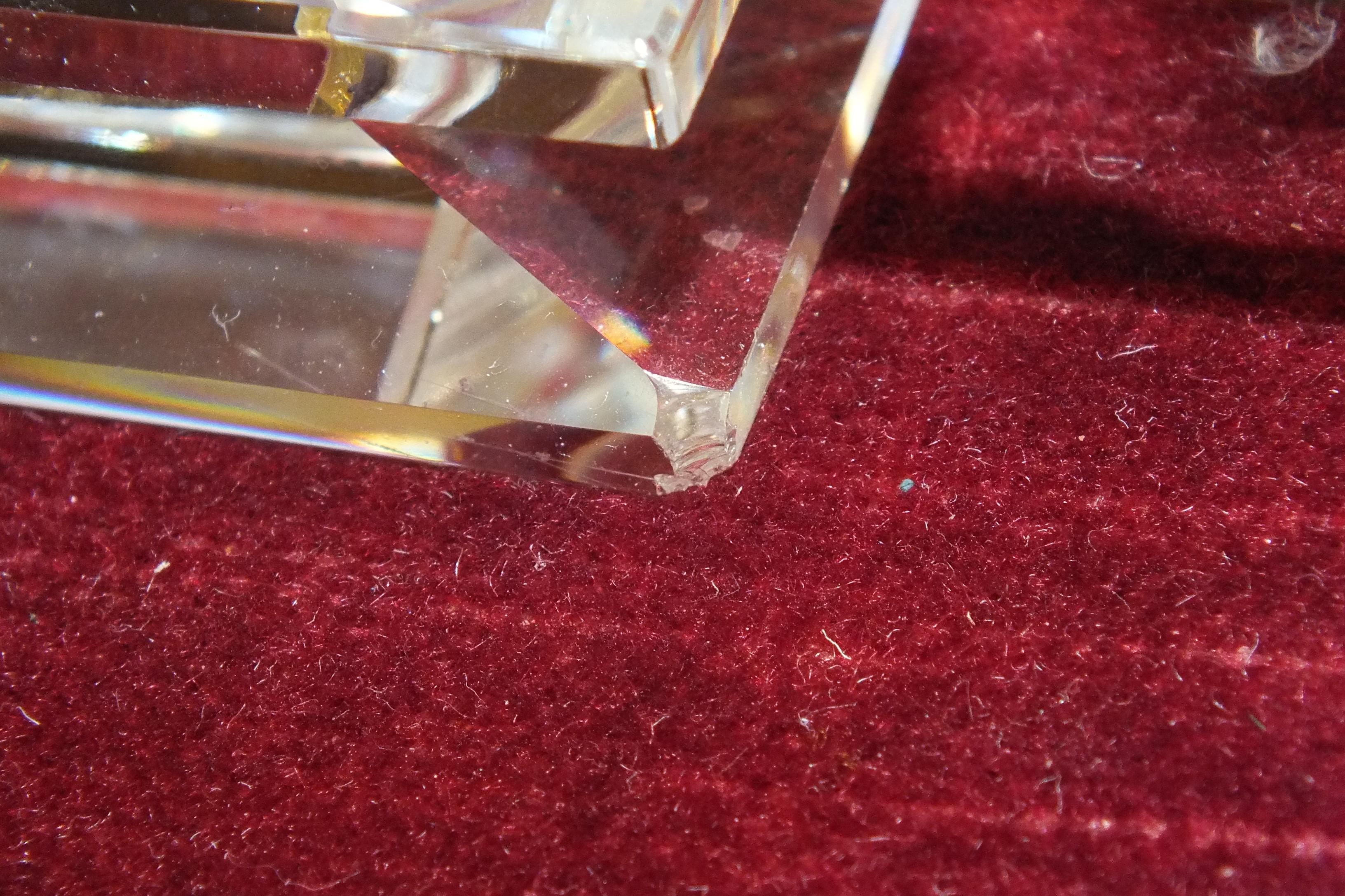 Lot 69 - A Swarovski cut-crystal five-light pricket candelabrum, 32cm long, (small chip) and a modern