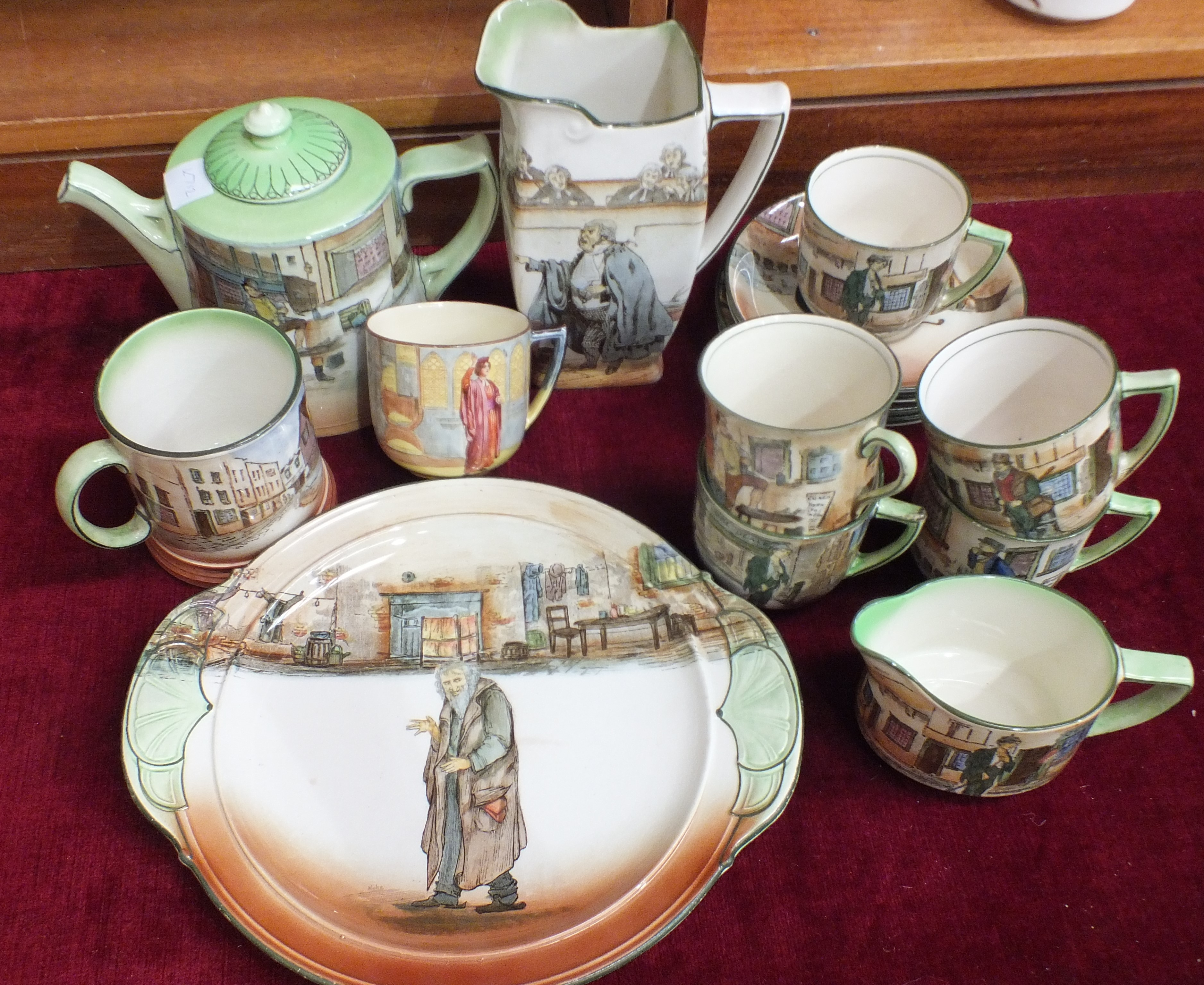"""Lot 79 - A Royal Doulton Dickens ware circular two-handled plate signed 'Noke', """"Fagin"""", five cups and"""