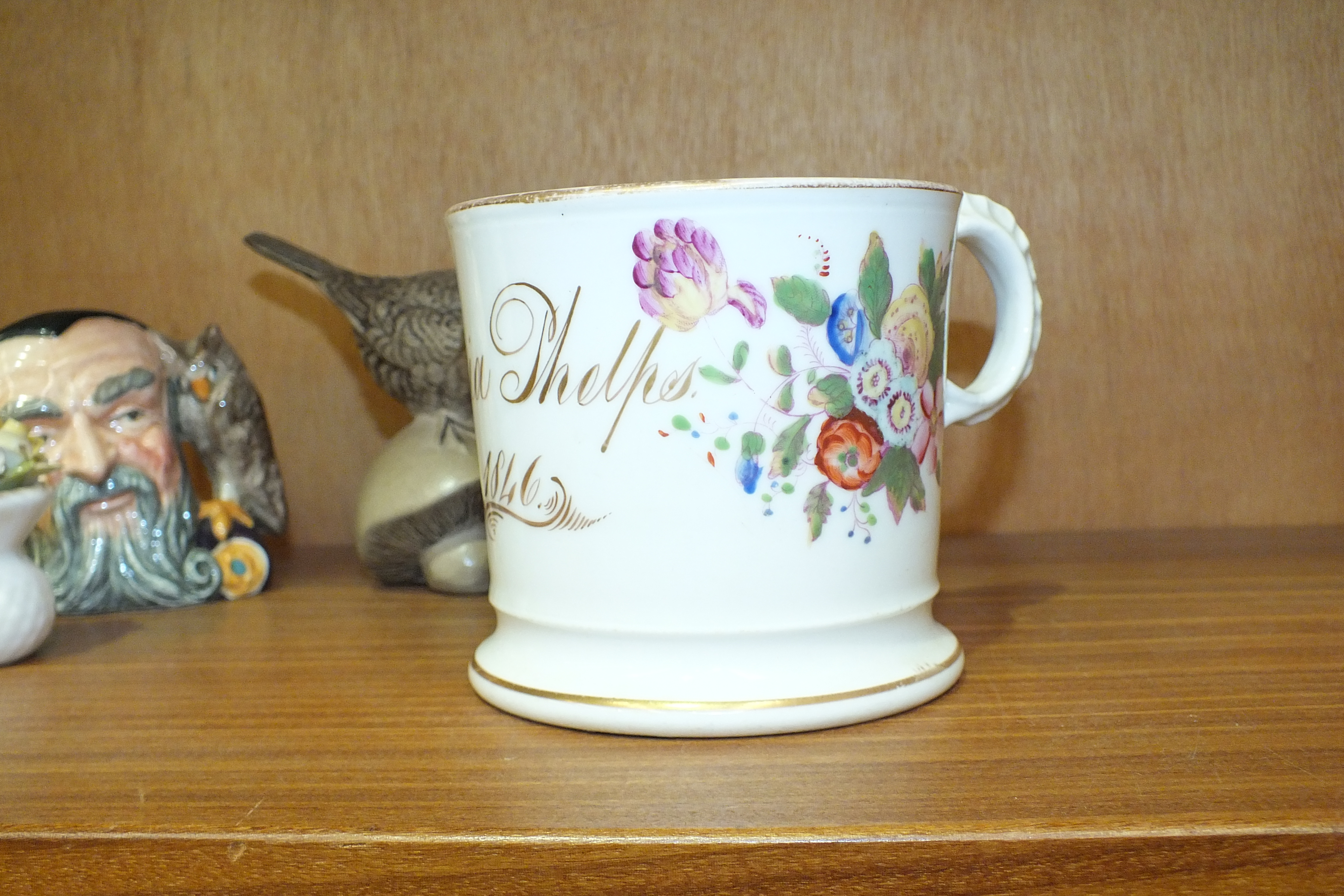 Lot 71 - A 19th century ceramic mug decorated with floral sprays and with gilded name 'Maria Phelps 1846',