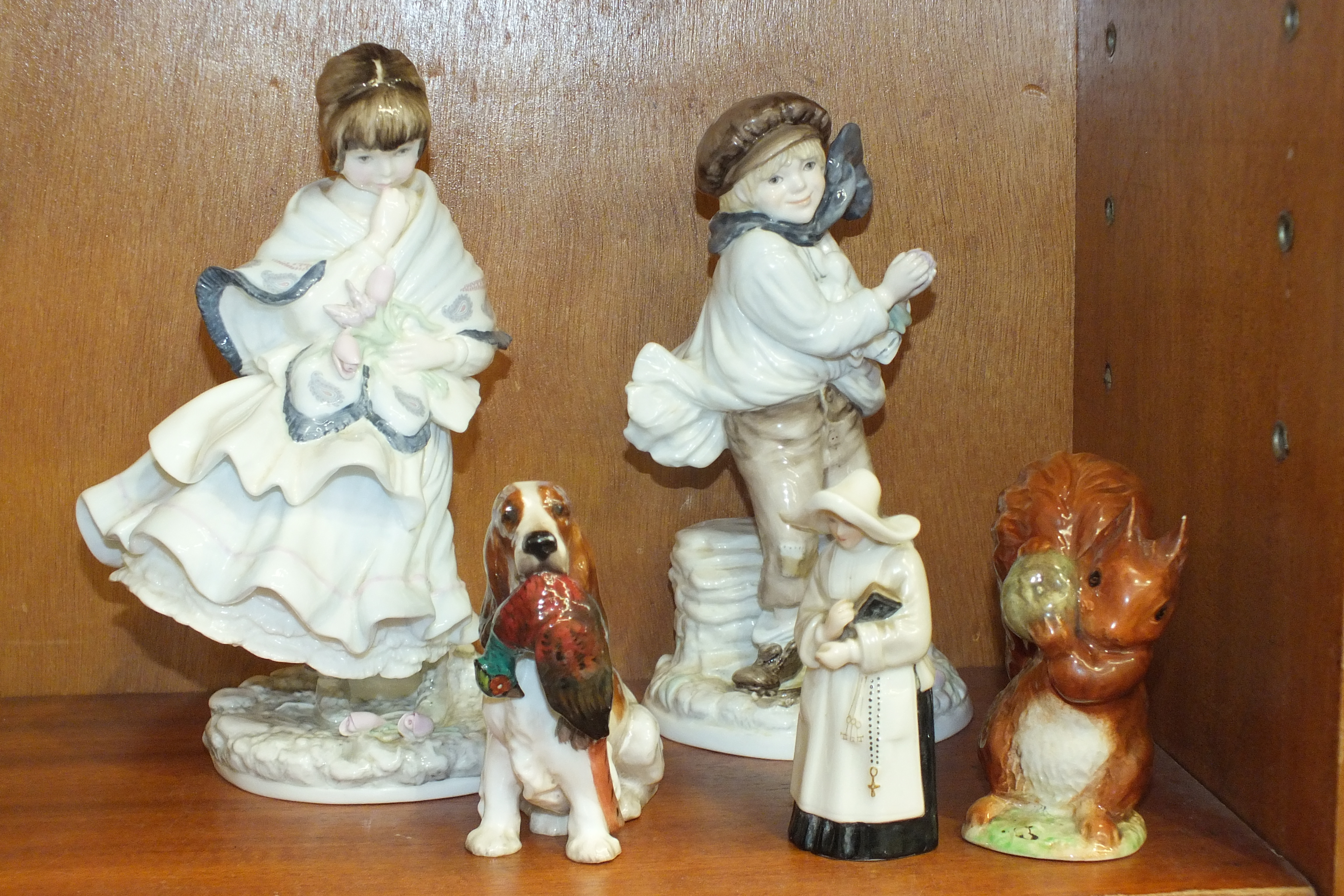 Lot 137 - A Royal Doulton model of a spaniel holding a pheasant, a Royal Worcester snuffer in the form of a