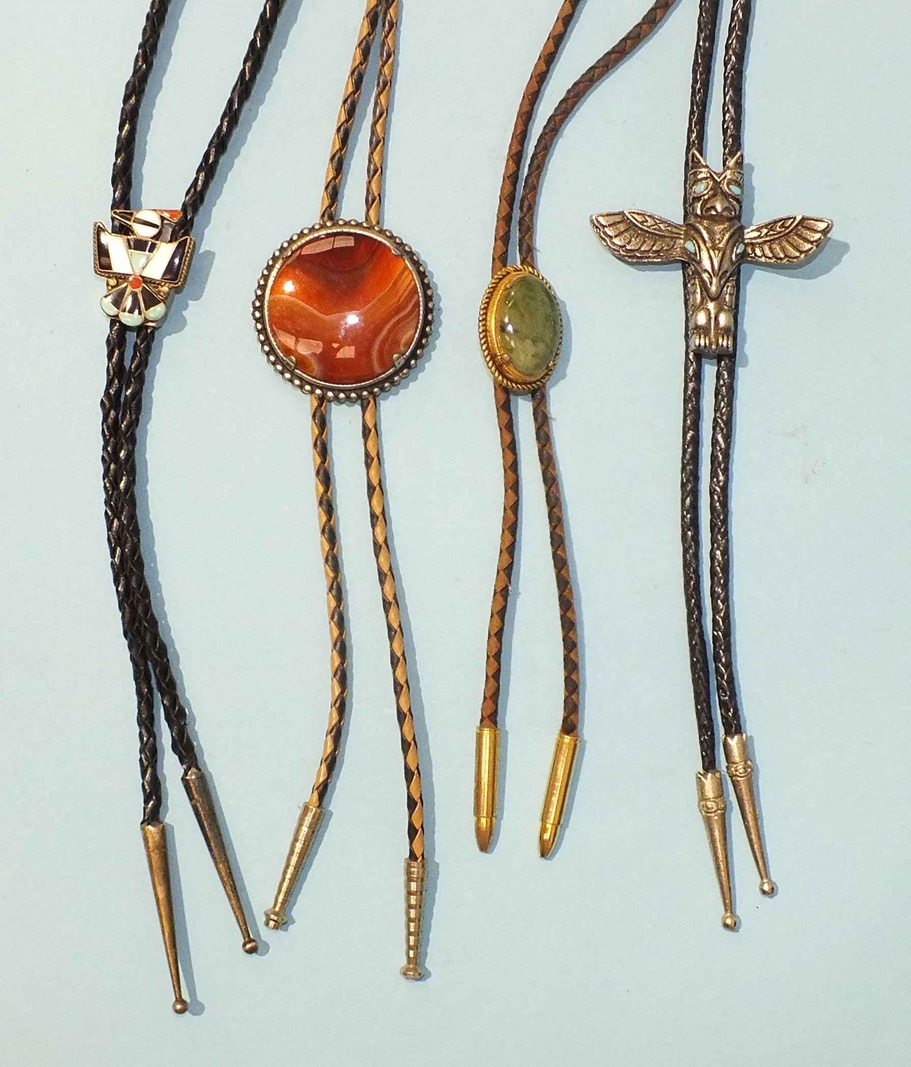 Lot 542 - A white metal and leather bolo inlaid with turquoise and stones set Thunderbird, probably H & E