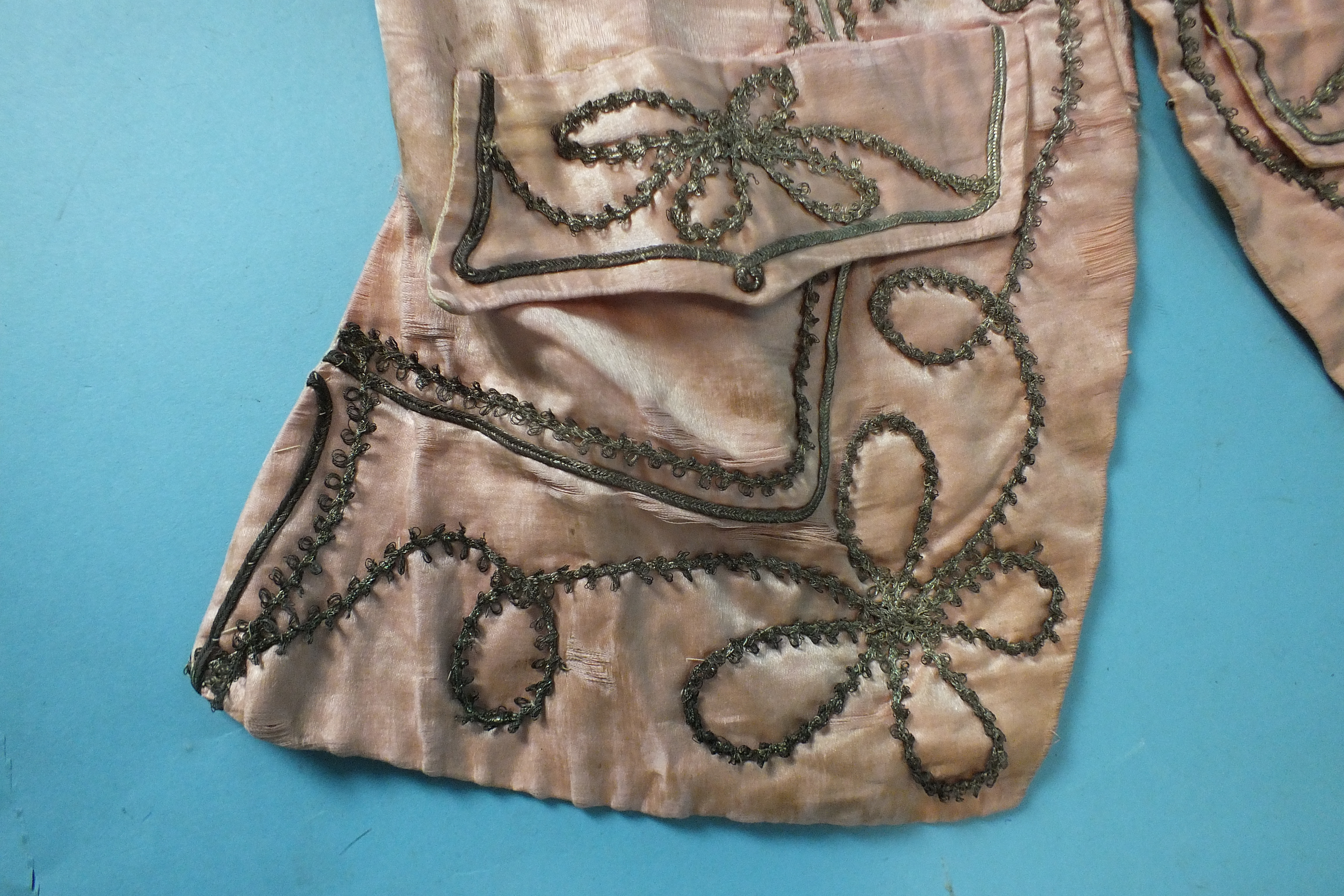Lot 532 - A late-18th century pale pink silk waistcoat, the front panels with applied silver lace and braid,