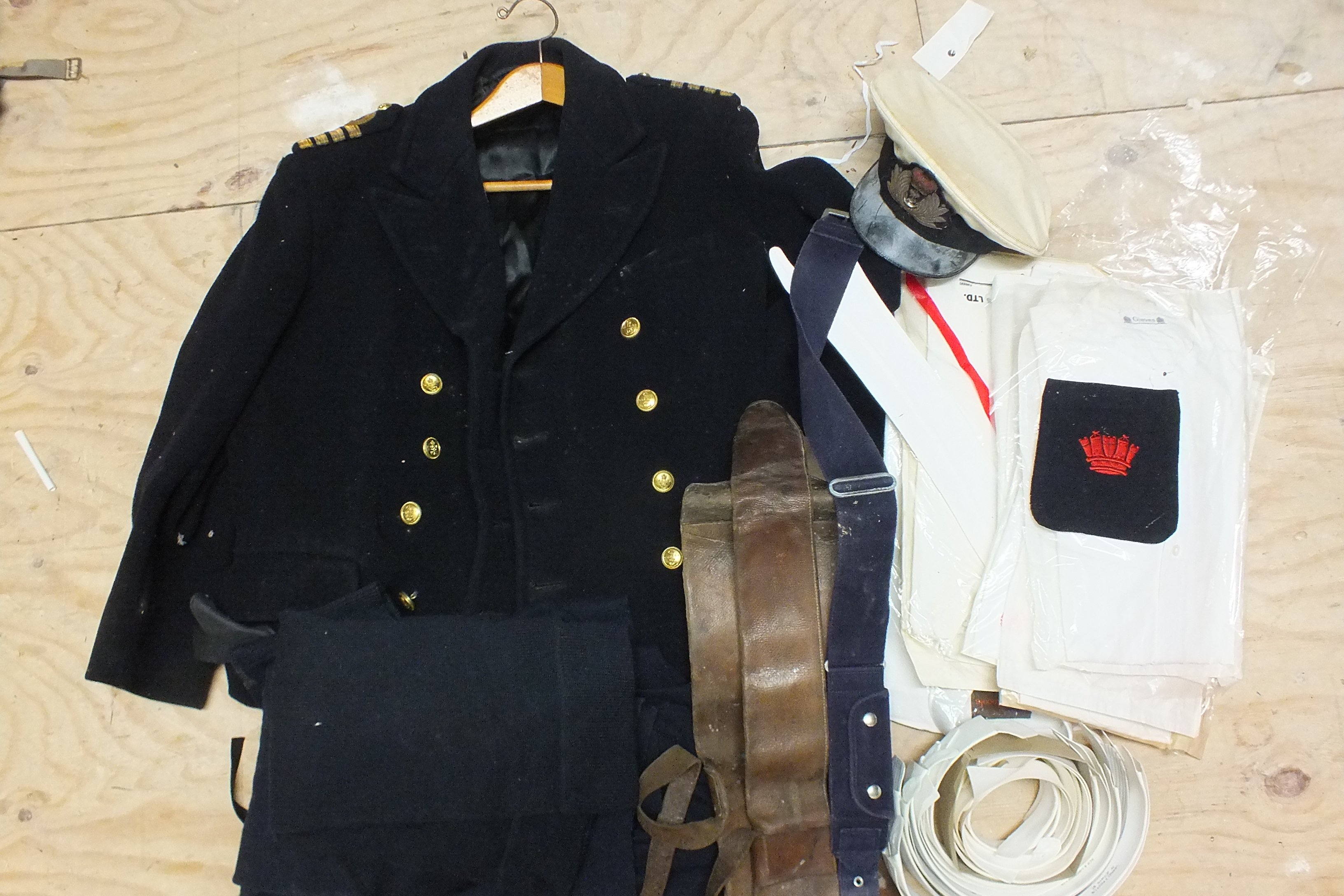 Lot 517 - A Royal Canadian Navy Gieves great coat c1950, (Captain), cap, seven Gieves collarless shirts and