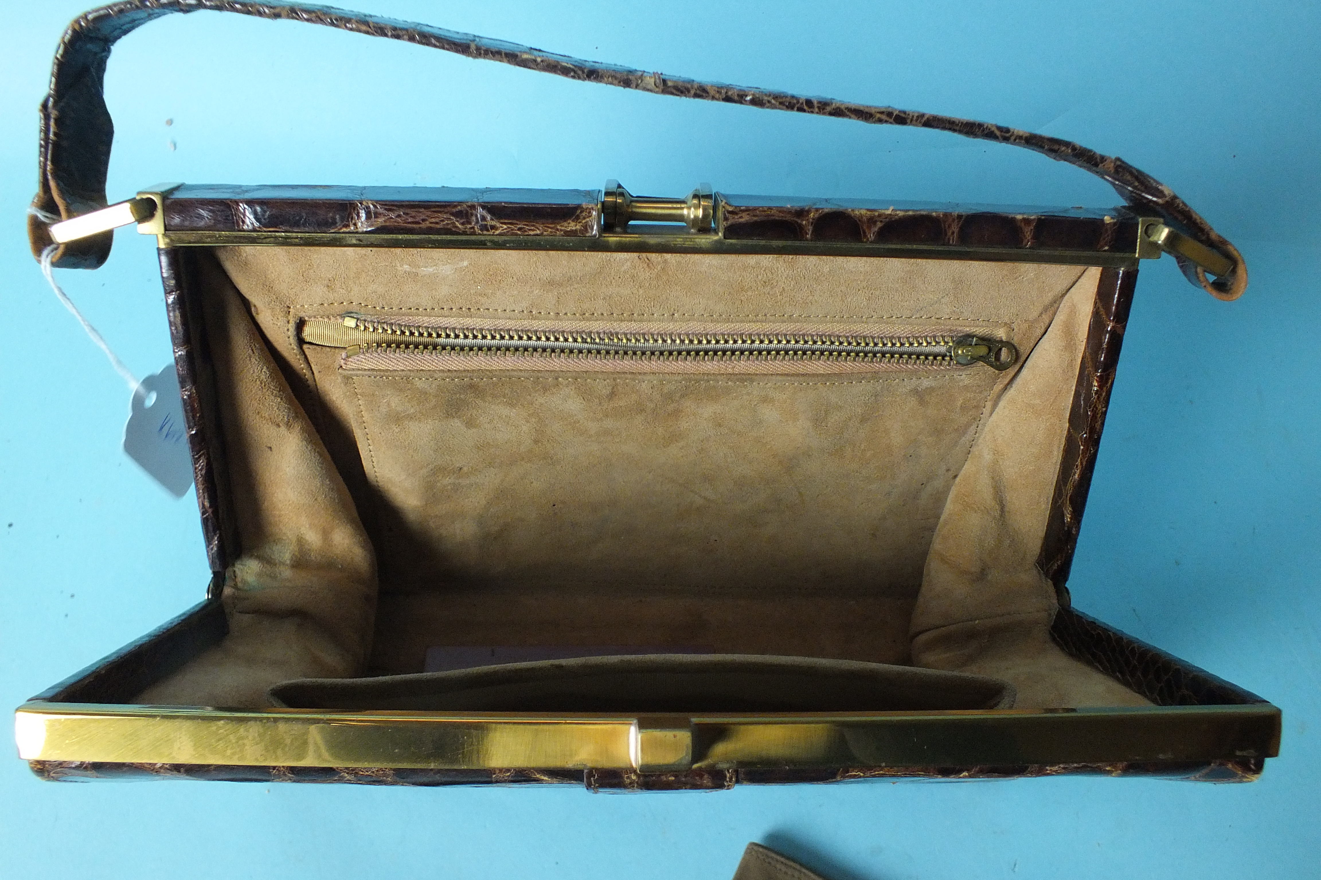 Lot 528 - A good-quality vintage crocodile handbag with suede and moiré lining, a similar purse and a pair