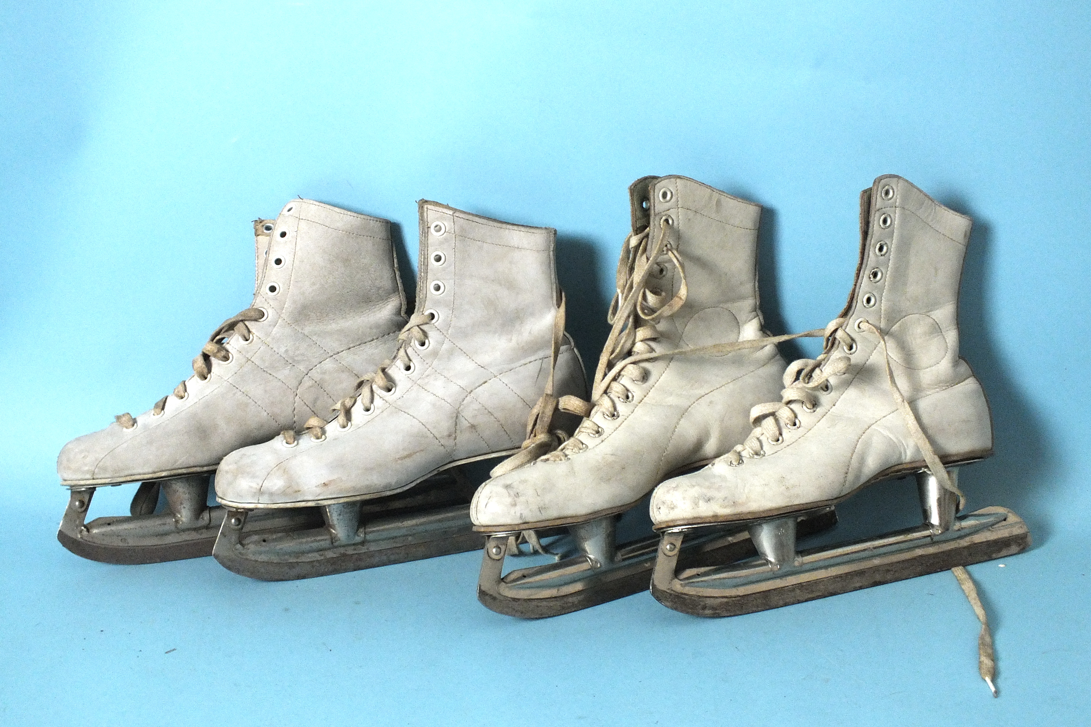 Lot 561 - Two pairs of lady's white leather ice skates.