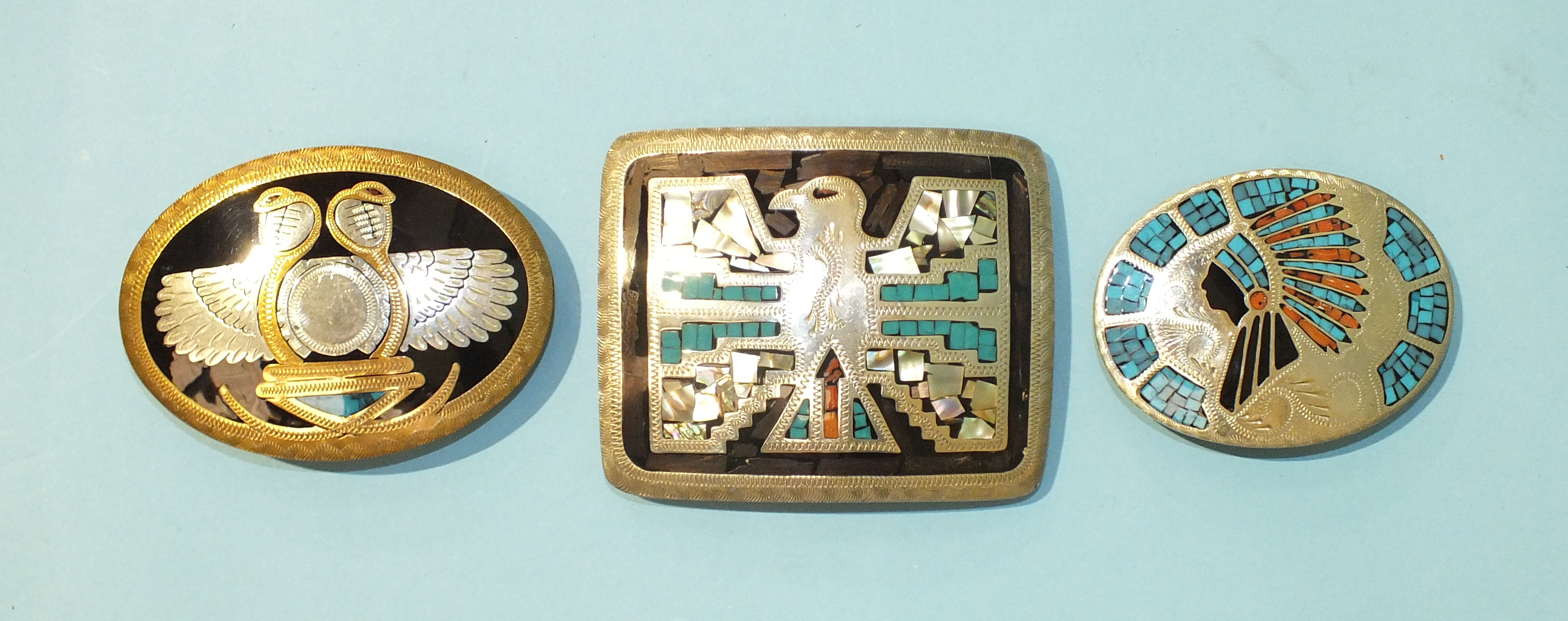 Lot 539 - A Johnson & Held Ltd white metal and enamel oval belt buckle set with turquoise and red stones, with