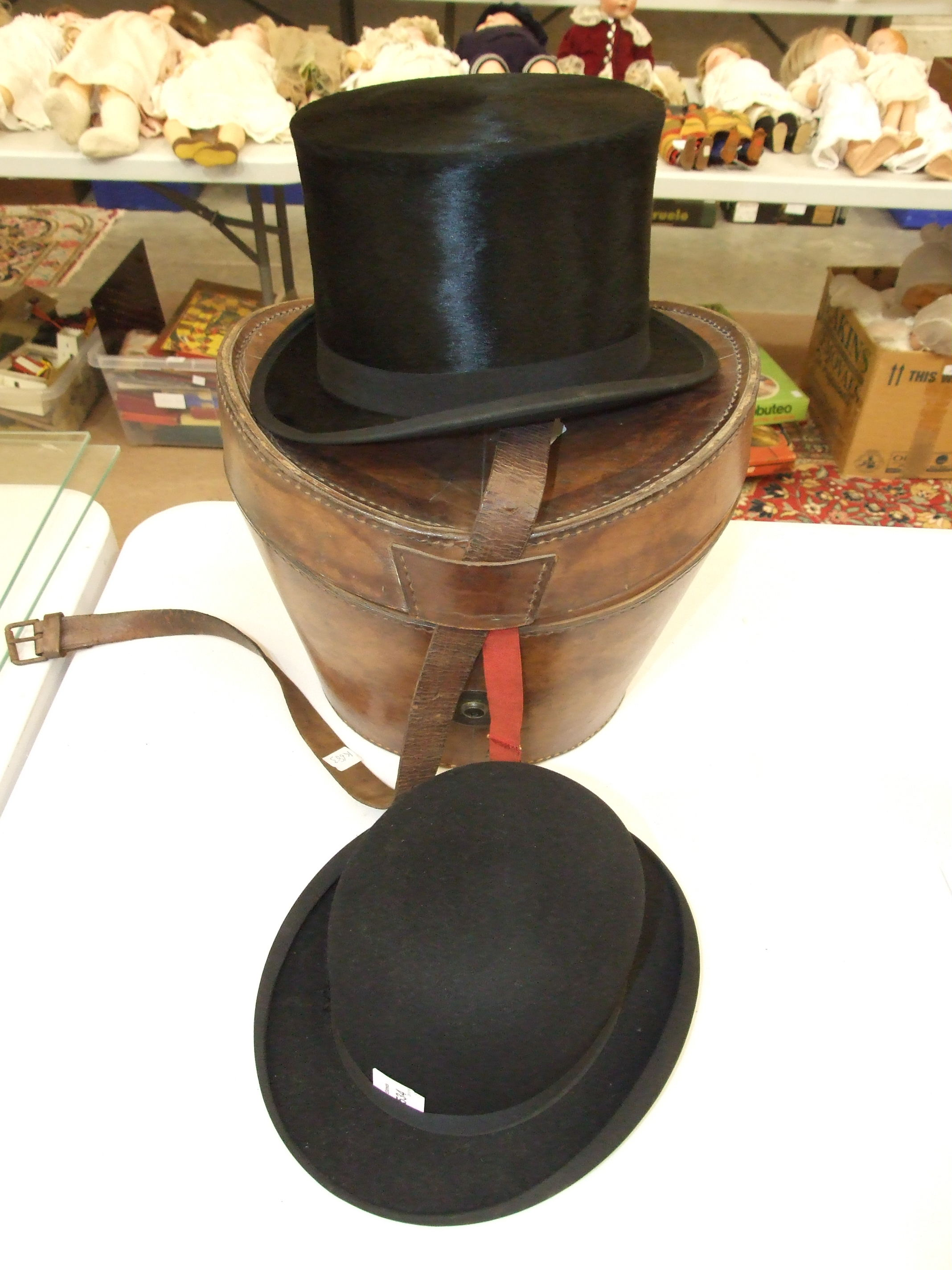 Lot 534 - An Isaac & Sons, Bath, all-fur top hat, approximate size 7¼, in Victorian leather hat box and a
