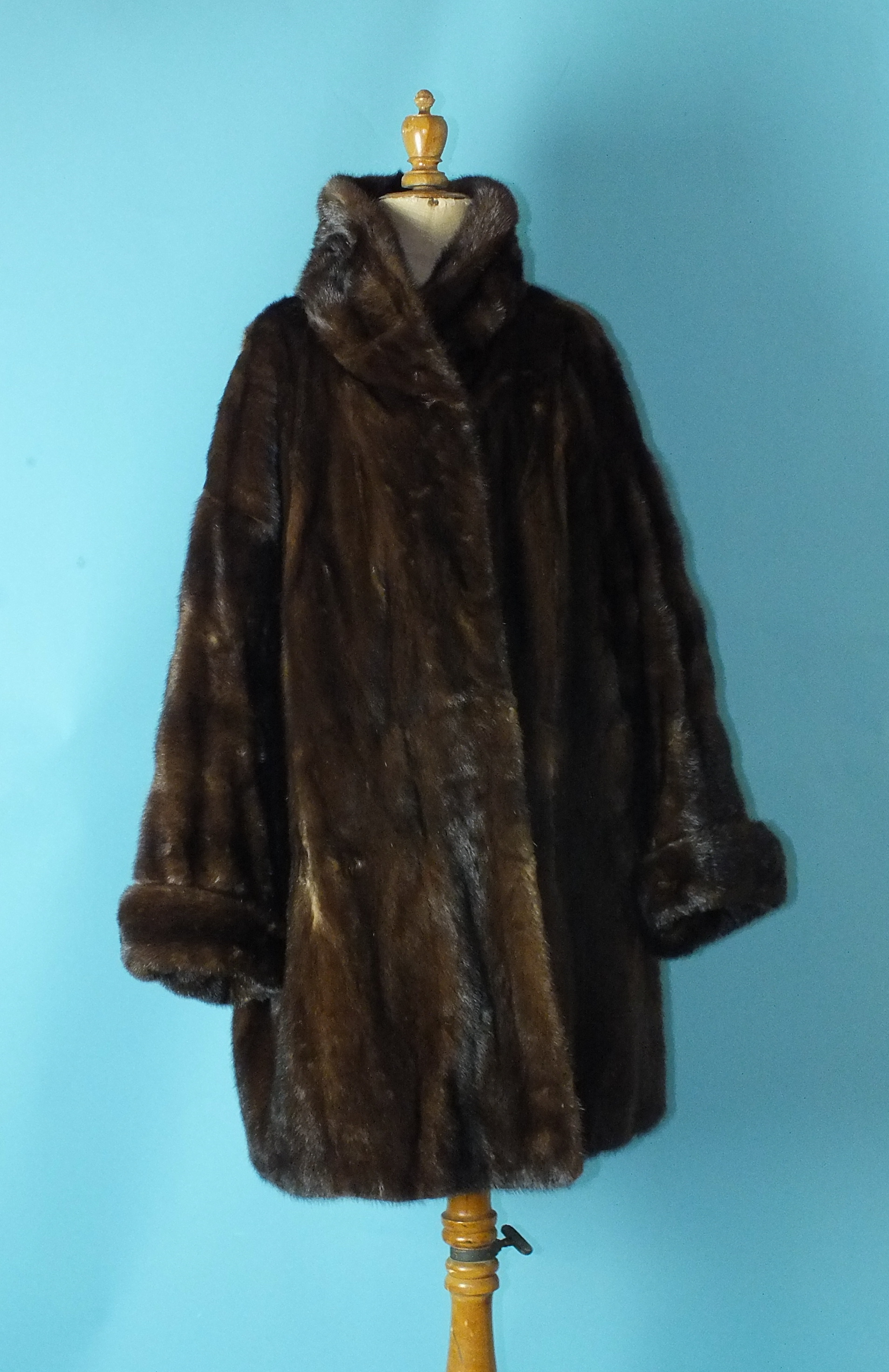 Lot 530 - A lady's brown mink coat, three-quarter length, with turned-up cuffs and roll neck, labelled for