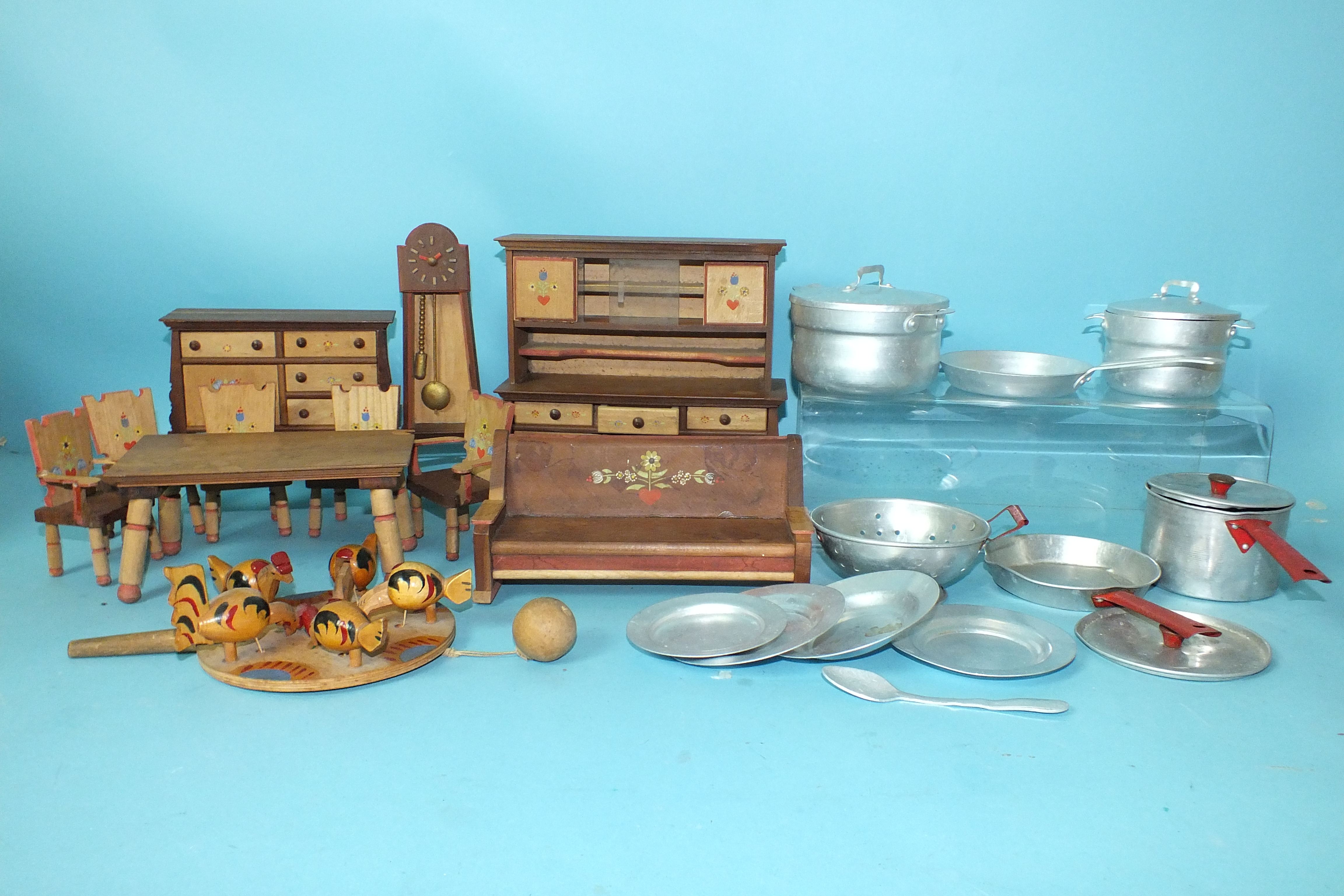 Lot 453 - A quantity of Swiss-style wooden doll's furniture: dresser, clock, sideboard, settee, table and five