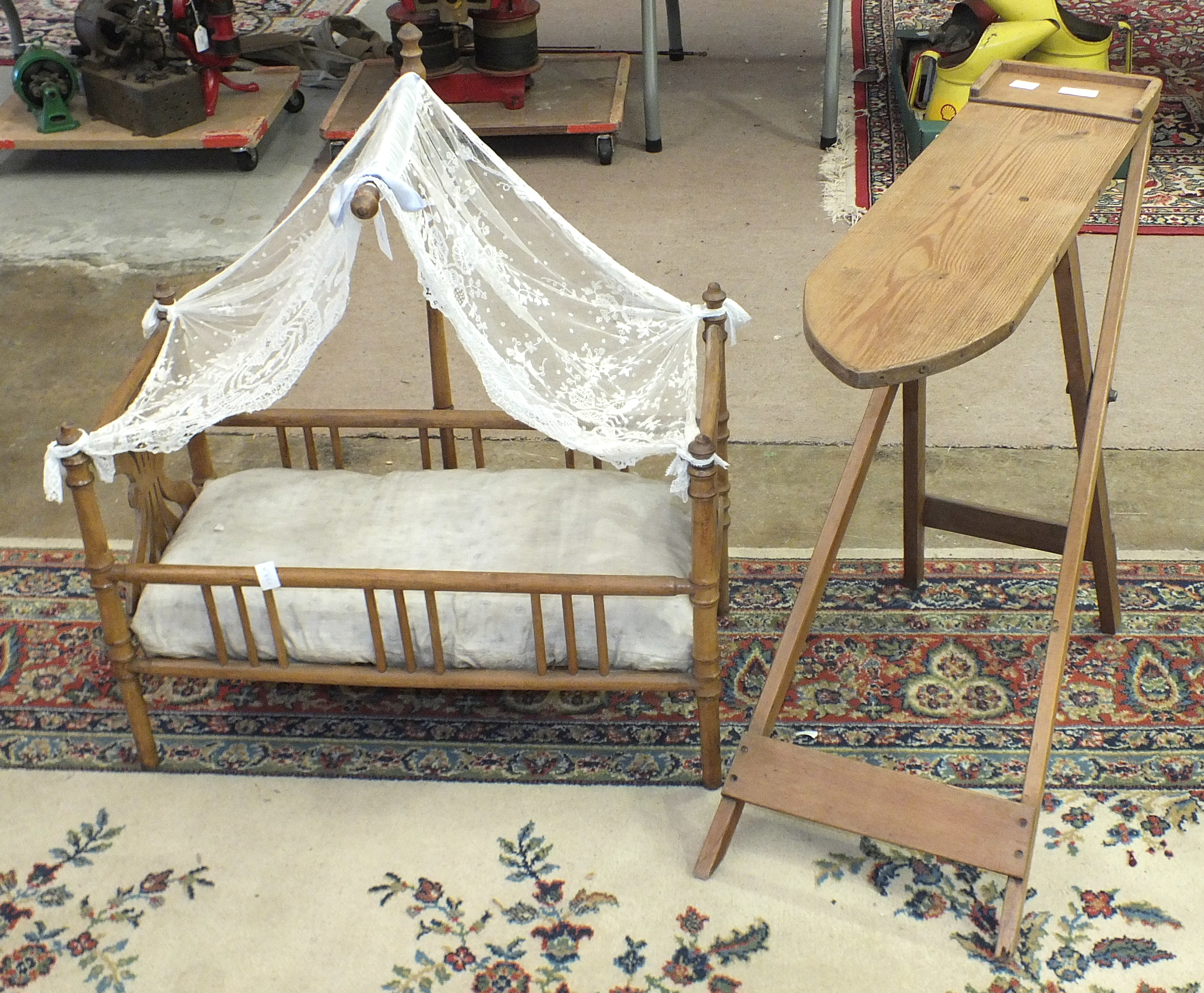 Lot 514 - A doll's metamorphic high chair, a turned wood cot with mattress, 62cm long, 64cm high and a child's