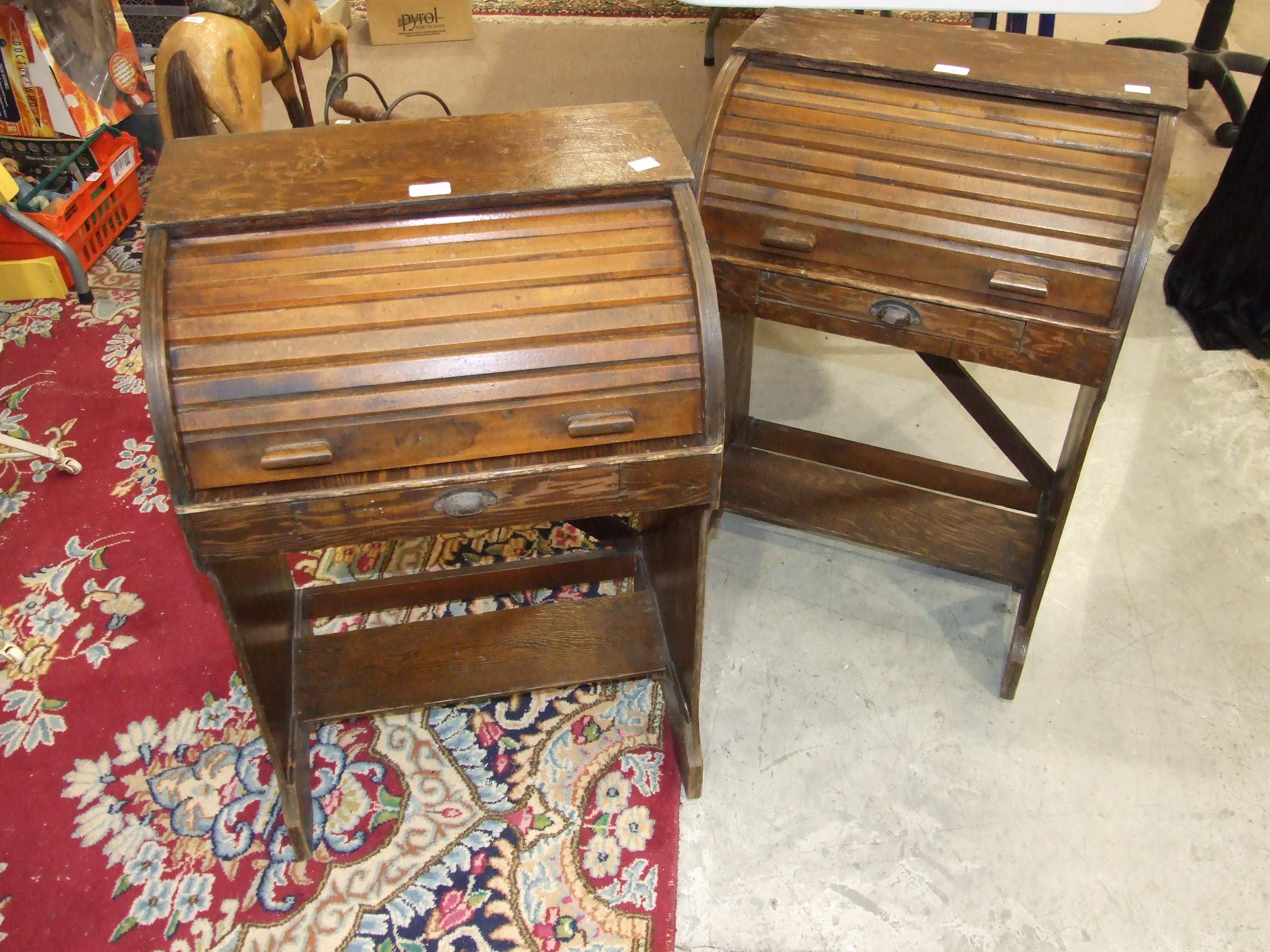 Lot 516 - A pair of children's pitch pine roll-top desks, 52cm wide, 77cm high, (2).