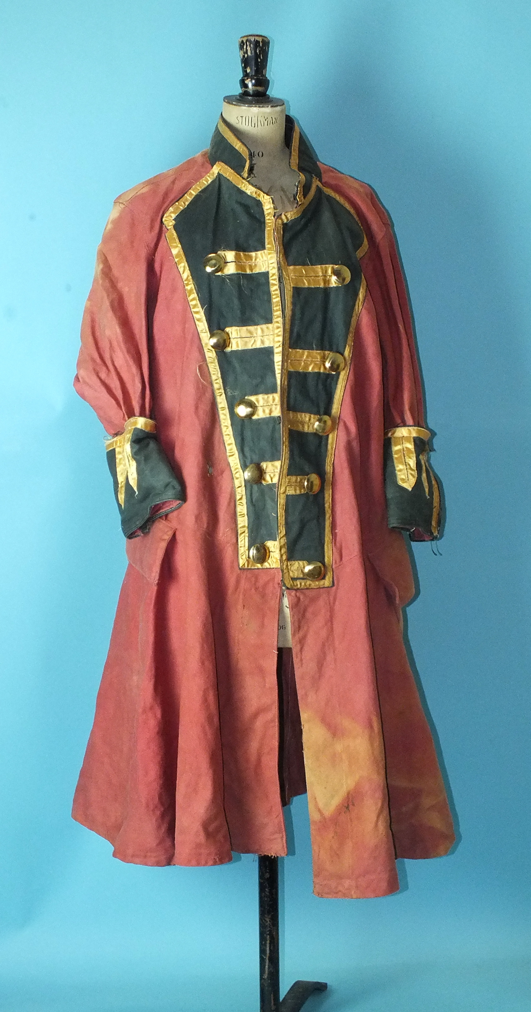 Lot 526 - A canvas 18th century-style frock coat, a fur coat and other dressing-up items.
