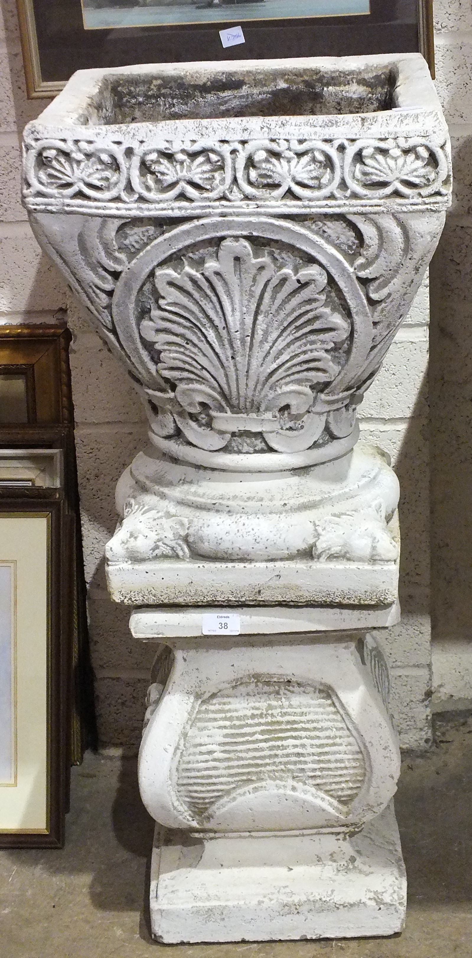 Lot 38 - A modern cast concrete planter on stand, 90cm high.
