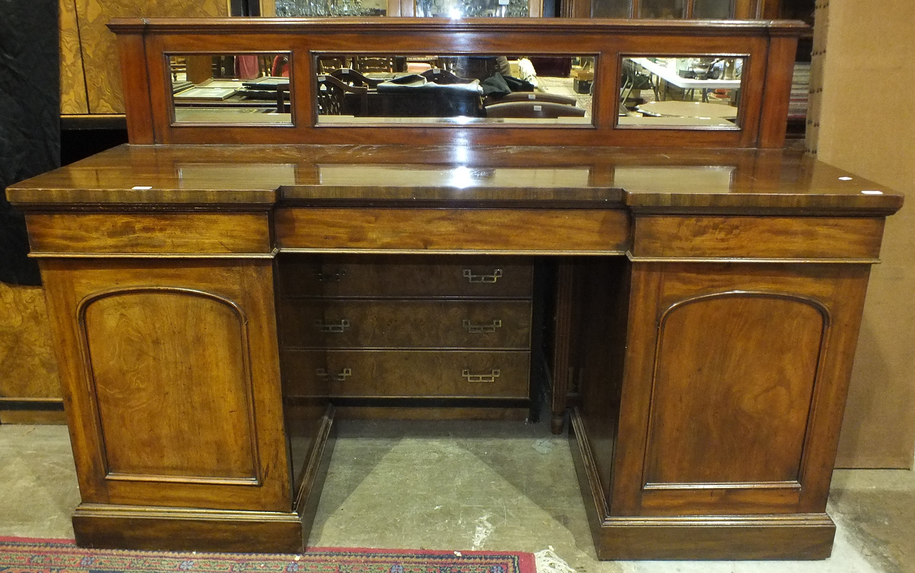 Lot 19 - A Victorian mahogany pedestal sideboard, the mirrored low back above three frieze drawers and a pair