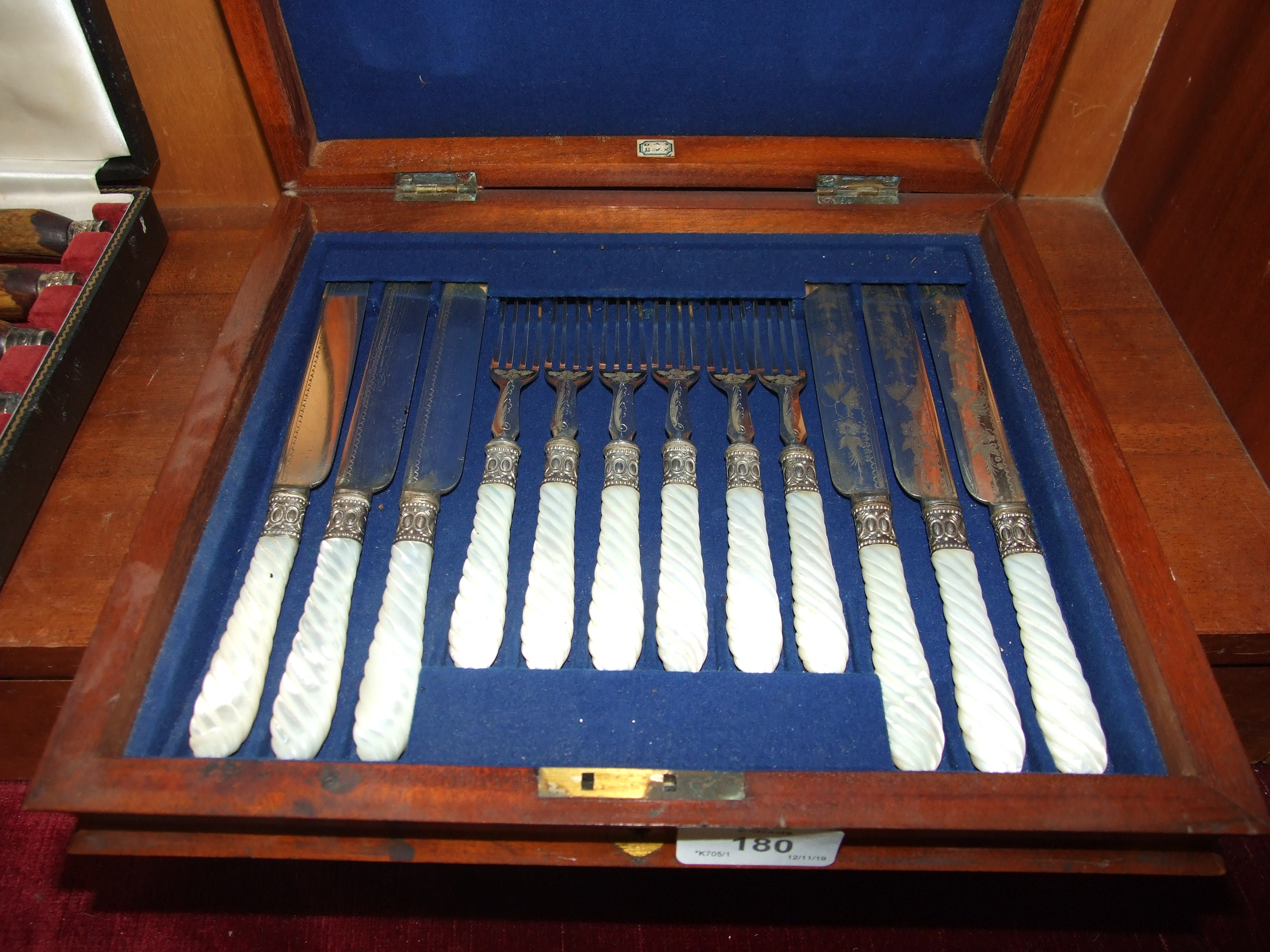Lot 180 - A set of six plated dessert eaters with mother-of-pearl handles, in case.