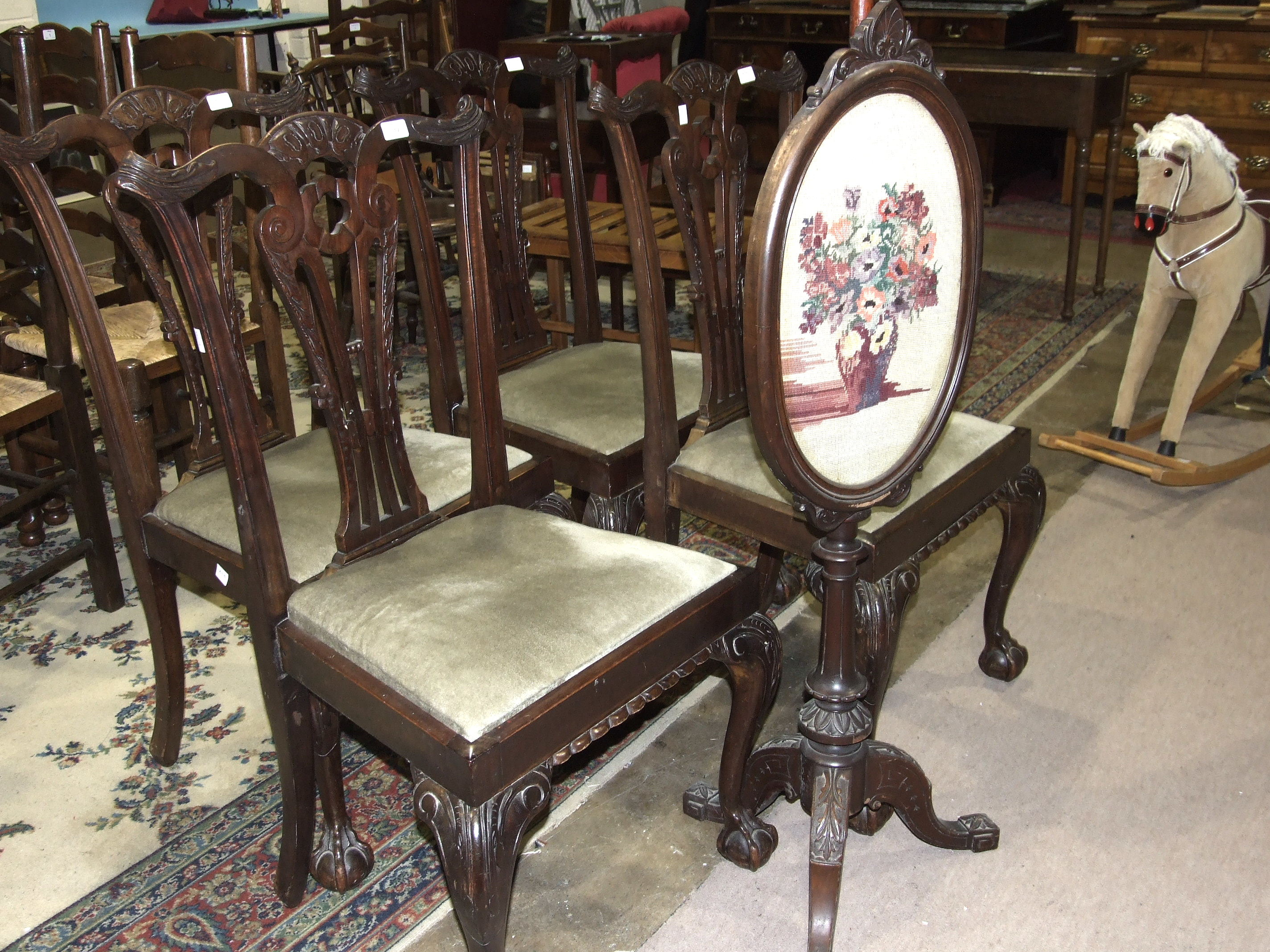 Lot 17 - A set of four Chippendale-style mahogany dining chairs and a Victorian mahogany pole screen, (5).