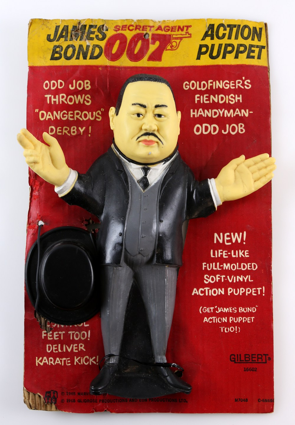 Lot 1023 - James Bond 007 - Gilbert Oddjob Action Puppet from 1965, 16602, Original card, 13 inches approx..