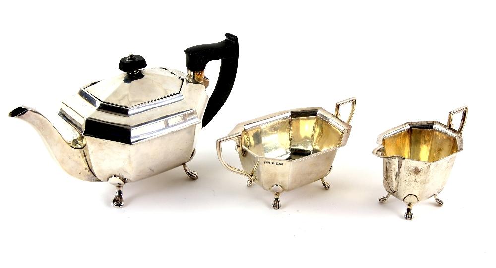 Lot 2032A - George VI silver three piece tea service, comprising teapot, cream jug and sugar bowl, of