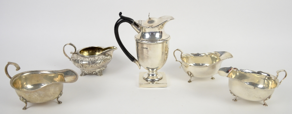 Lot 2038 - William IV silver cream jug, by Charles Fox II, London 1835, the squat body chased with floral