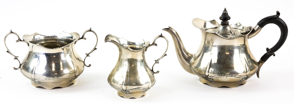 Lot 2037 - Edward VII bachelor's silver tea service, by Levesley Brothers, Sheffield 1907/08, with scalloped