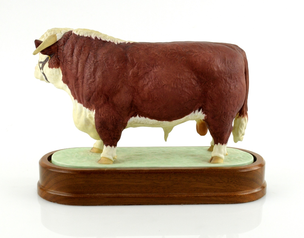 Lot 3010 - Royal Worcester porcelain Hereford Bull modelled by Doris Lindner 1959, 14.5cm in length x 18cm high