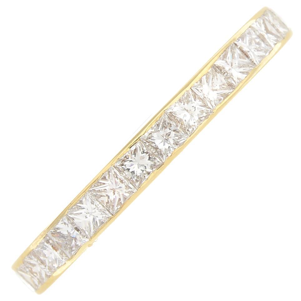 Lot 17 - An 18ct gold square-shape diamond full eternity ring.