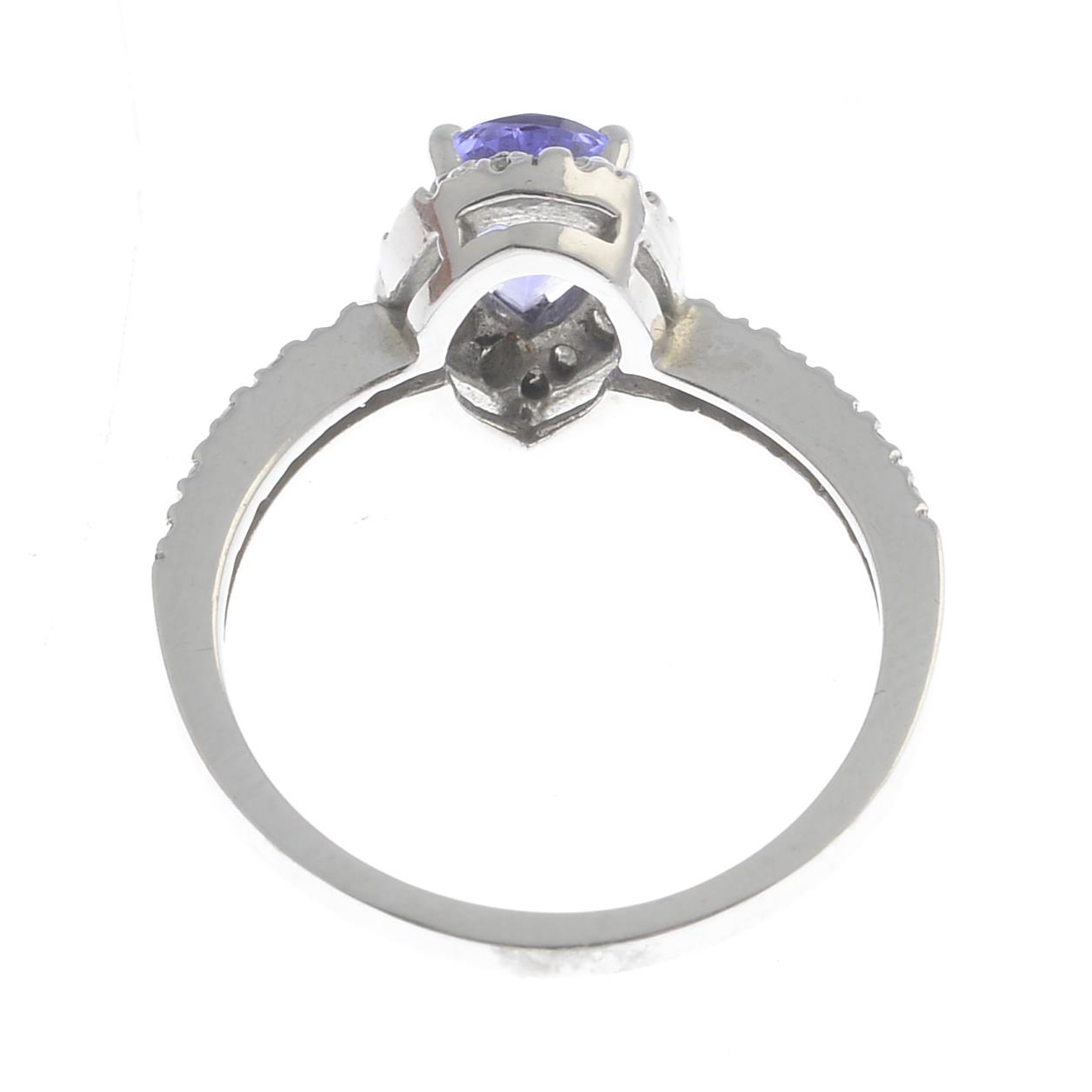 Lot 22 - A tanzanite and diamond cluster ring.Estimated total diamond weight 0.20ct.Stamped 14k.