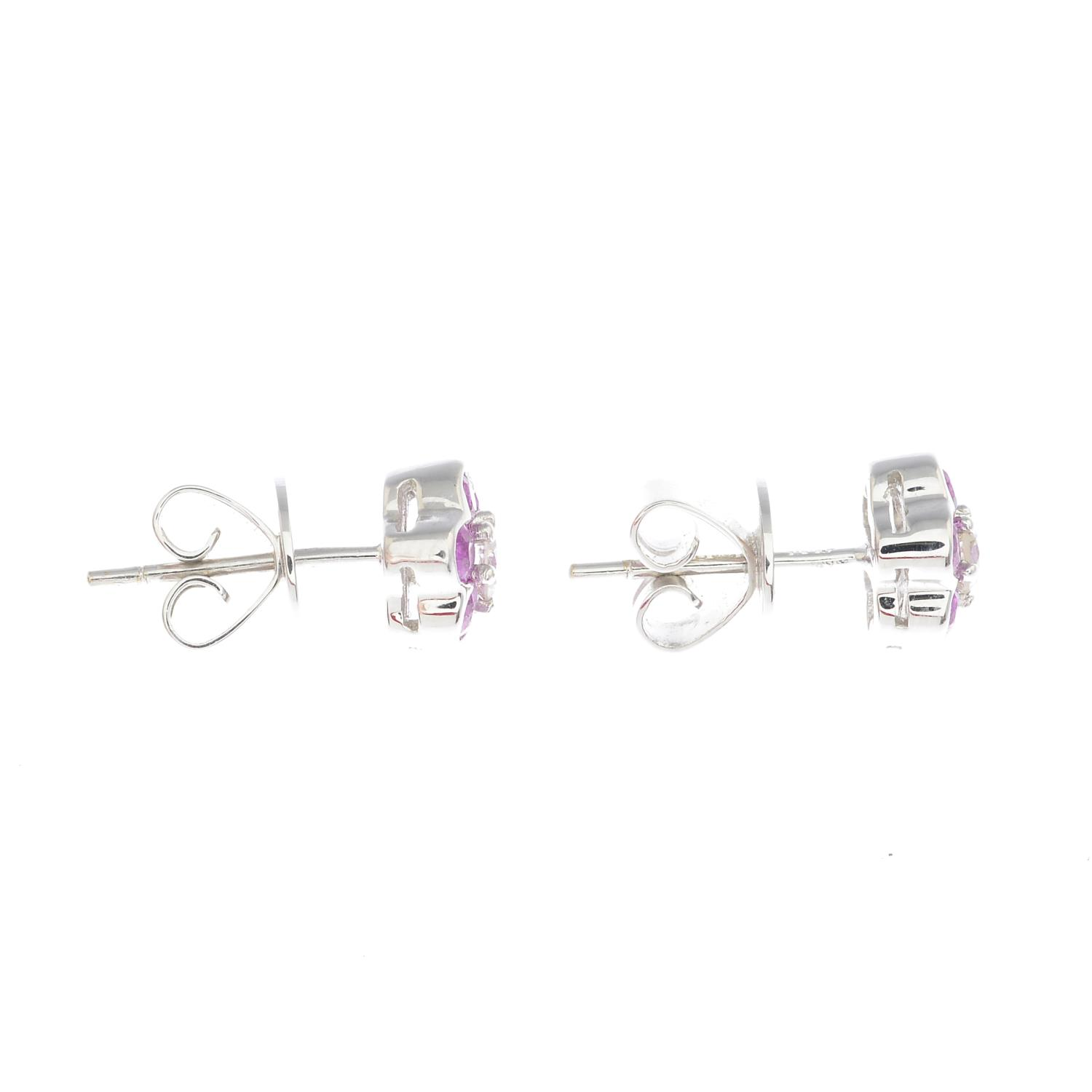 Lot 3 - A pair of 18ct gold pink sapphire and diamond floral cluster earrings.Estimated total diamond