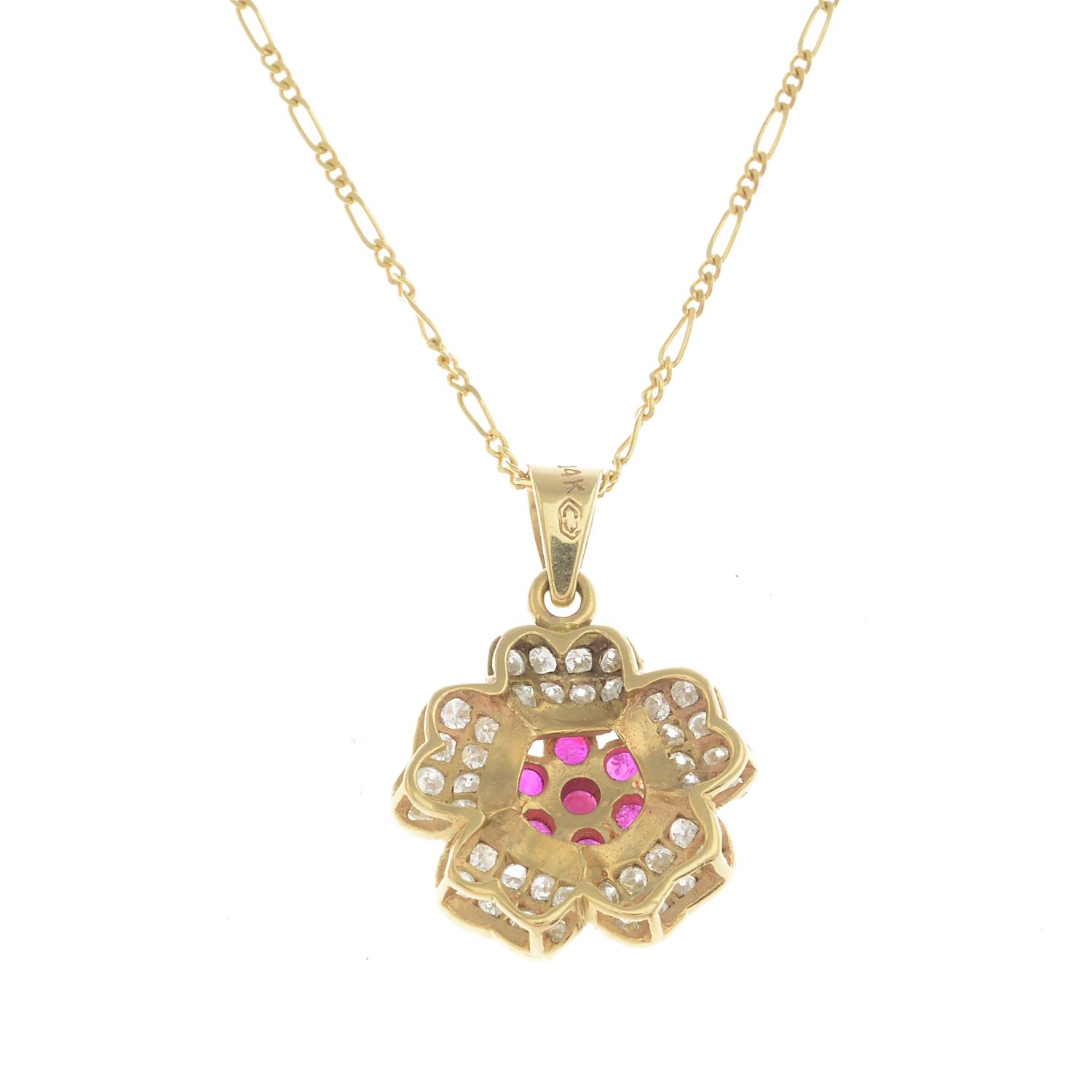 Lot 20 - A ruby and diamond floral cluster pendant,