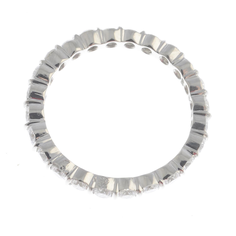 Lot 2 - A platinum diamond full eternity ring