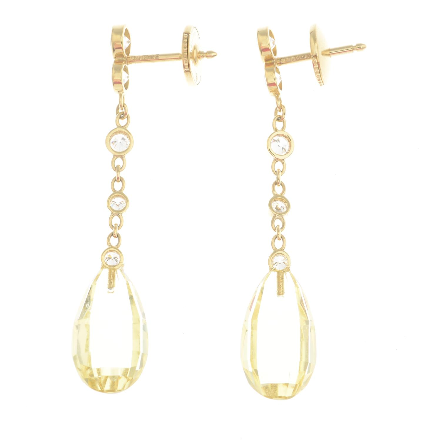 Lot 11 - A pair of 18ct gold heliodor and diamond earrings.