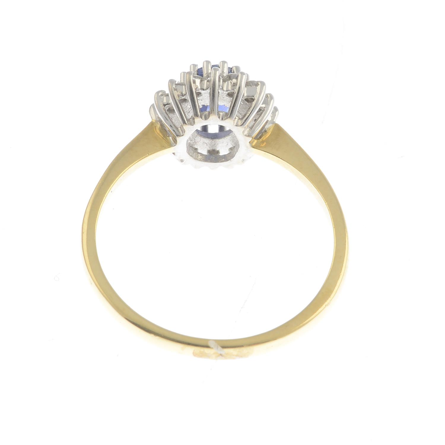 Lot 42 - An 18ct gold sapphire and diamond cluster ring.Calculated sapphire weight 0.80ct,