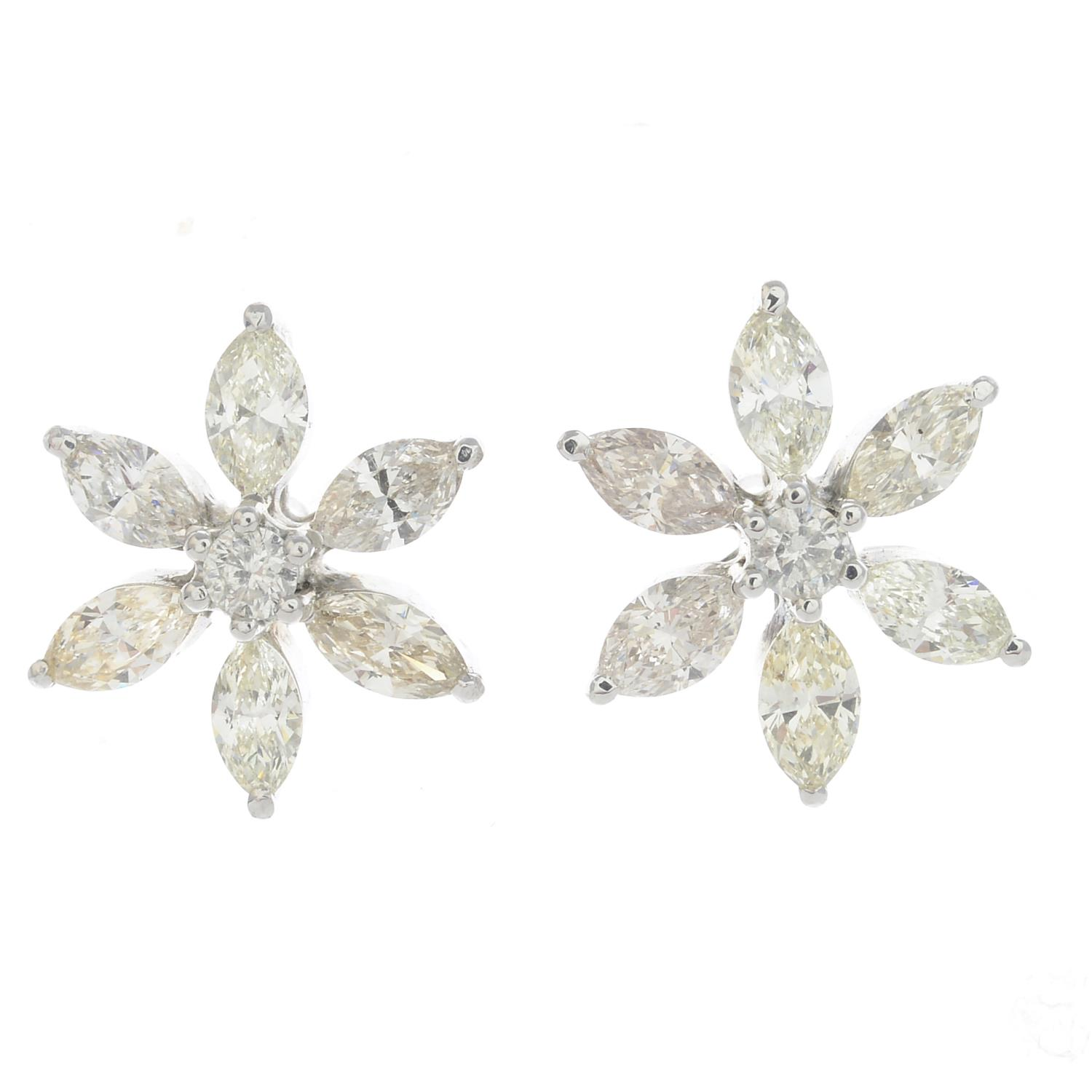 Lot 57 - A diamond flower ring and a pair of matching diamond flower earrings.Estimated total diamond weight