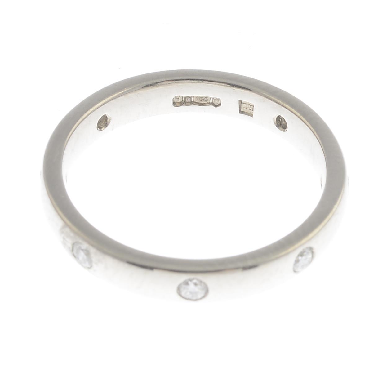 Lot 34 - A platinum brilliant-cut diamond band ring.