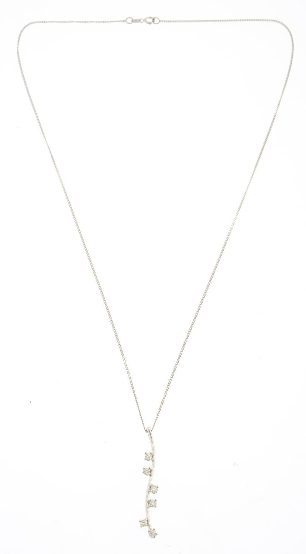 Lot 12 - An 18ct diamond pendant,