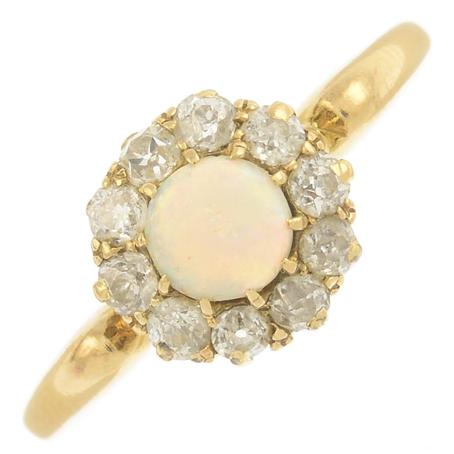 Lot 15 - An early 20th century 18ct gold opal and diamond cluster ring.Estimated total diamond weight