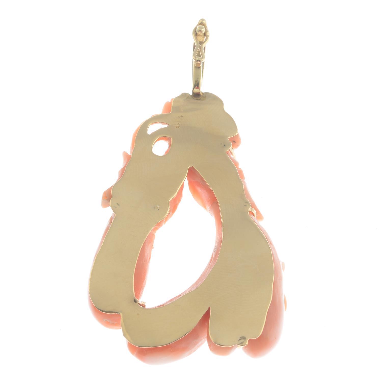 Lot 54 - A coral pendant.