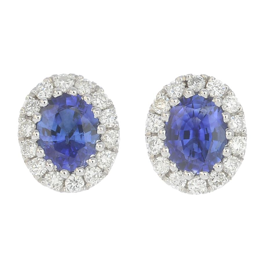 Lot 55 - A pair of sapphire and diamond earrings.Total sapphire weight 0.61ct,