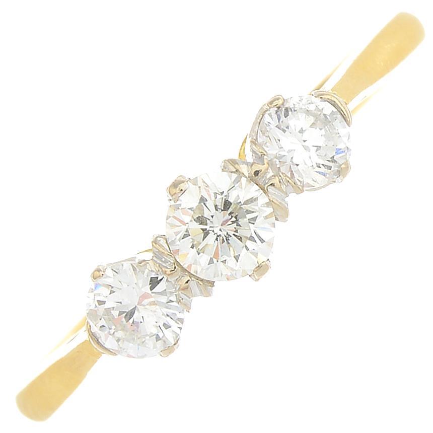 Lot 30 - An 18ct gold diamond three-stone ring.Estimated total diamond weight 0.50ct,