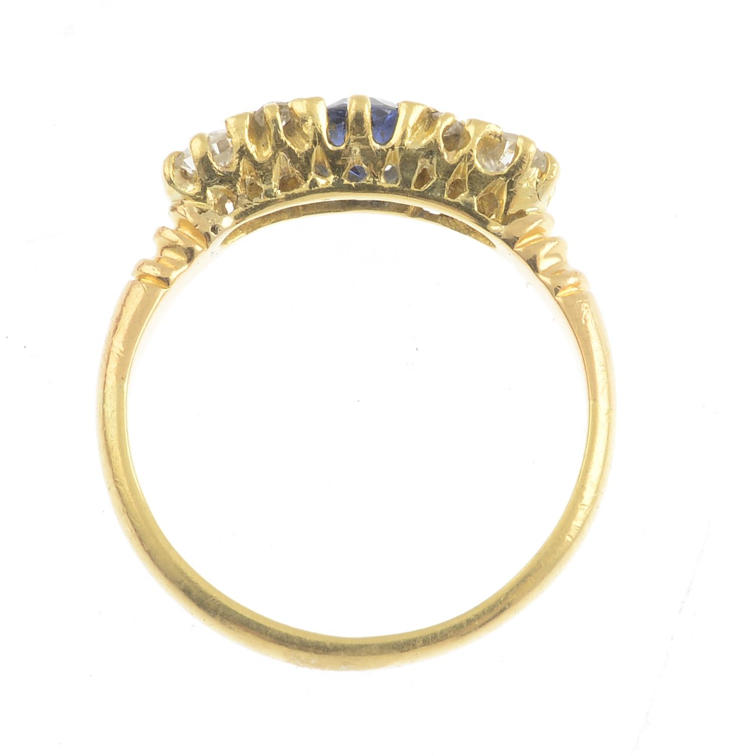 Lot 14 - A sapphire and diamond dress ring.Estimated total diamond weight 0.20ct.Ring size L.