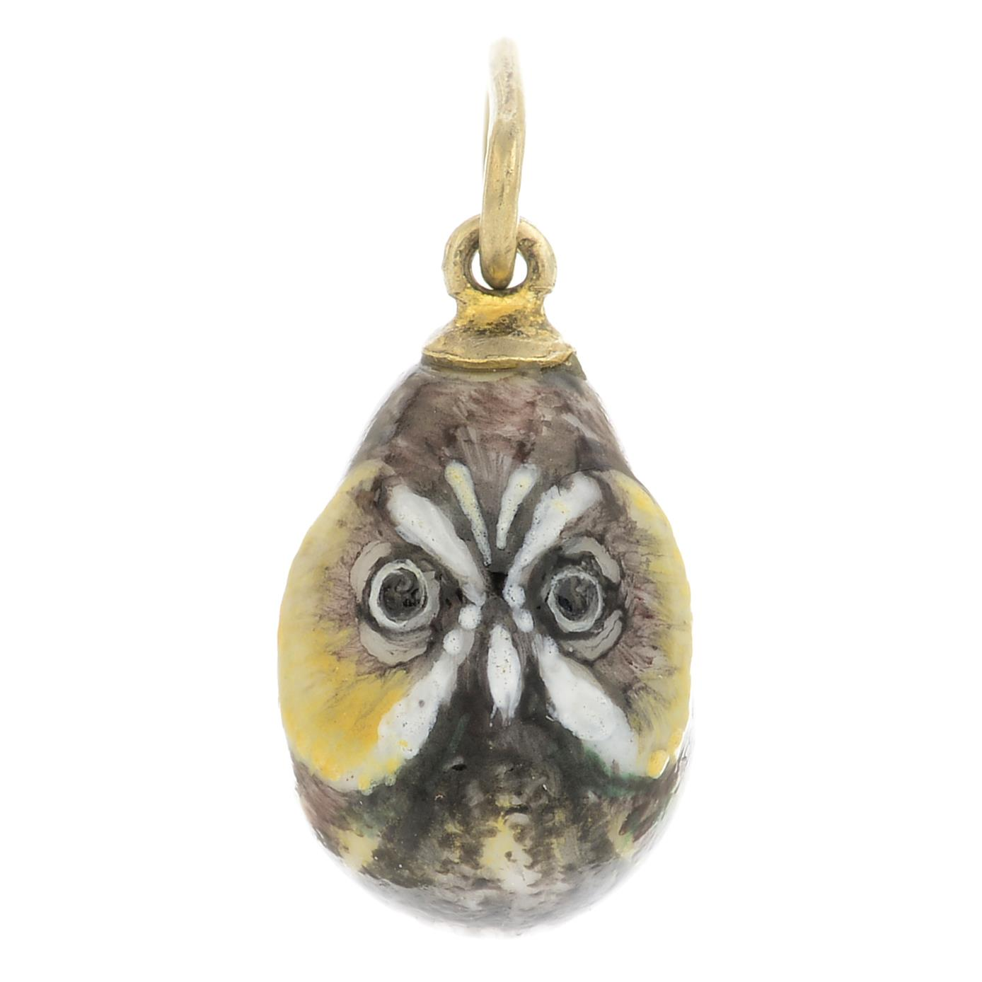 Lot 5 - An early 20th century enamel egg pendant, painted to depict an owl.Length 2.3cms.