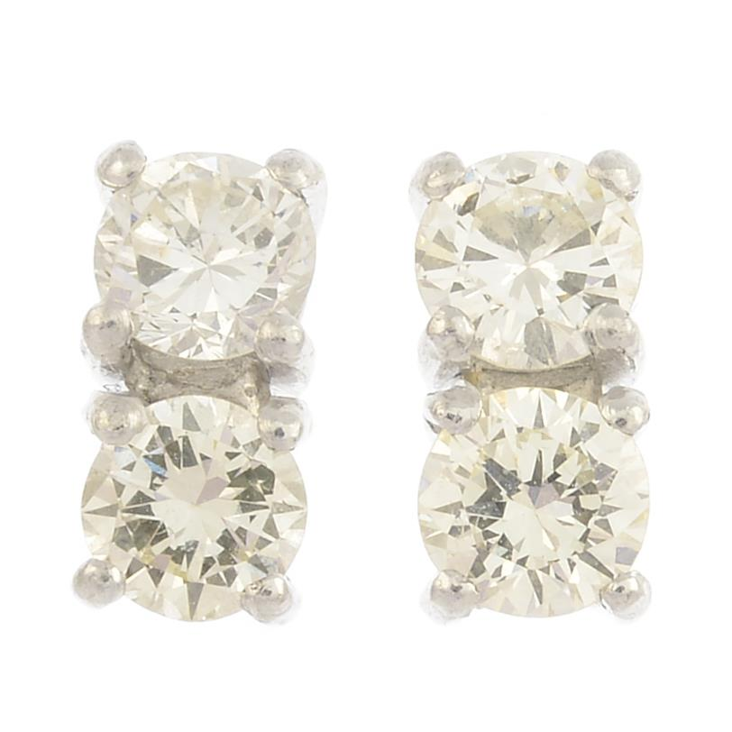 Lot 35 - A pair of brilliant-cut diamond earrings.Estimated total diamond weight 1ct,