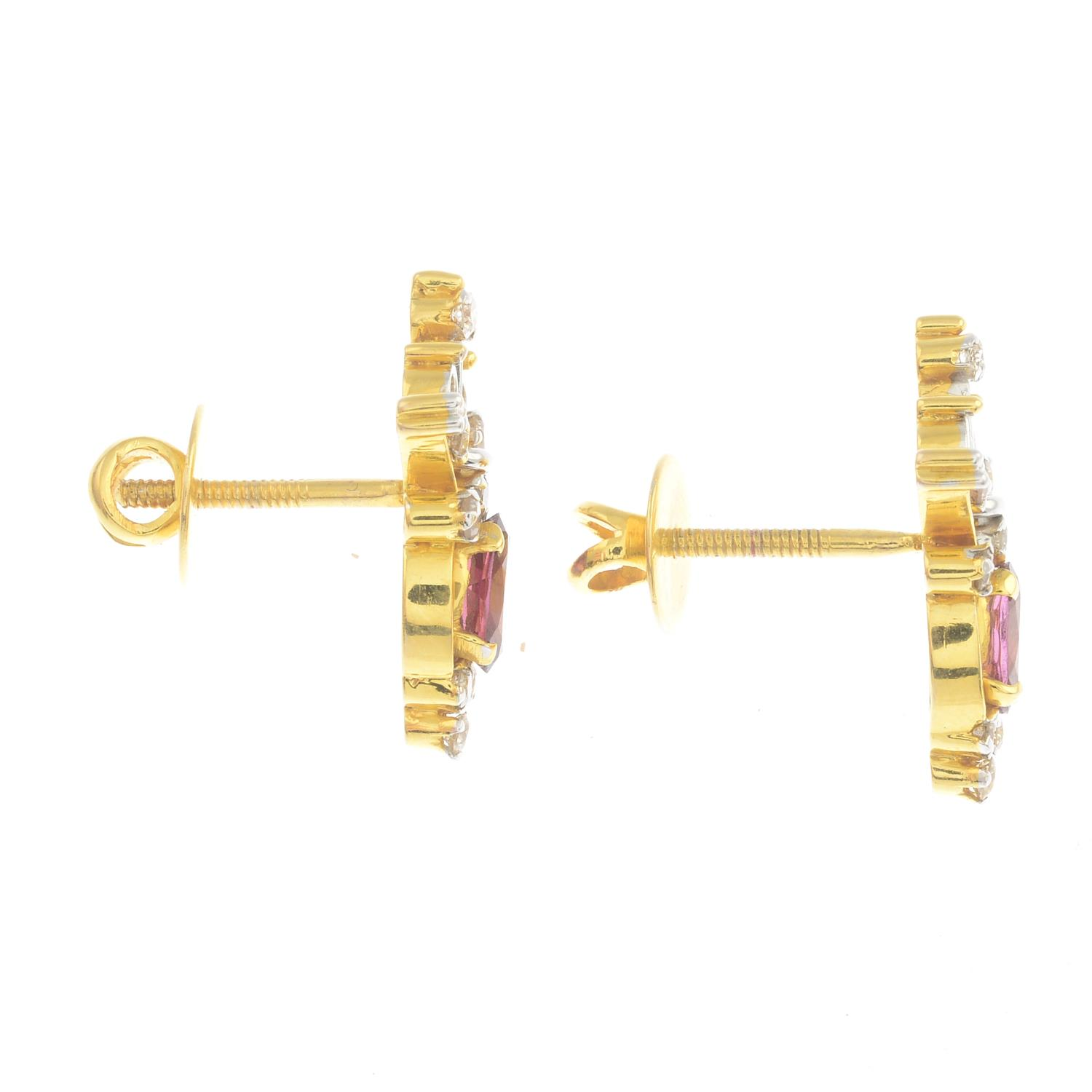 Lot 28 - A pair of diamond and garnet earrings.Total diamond weight 0.69ct,